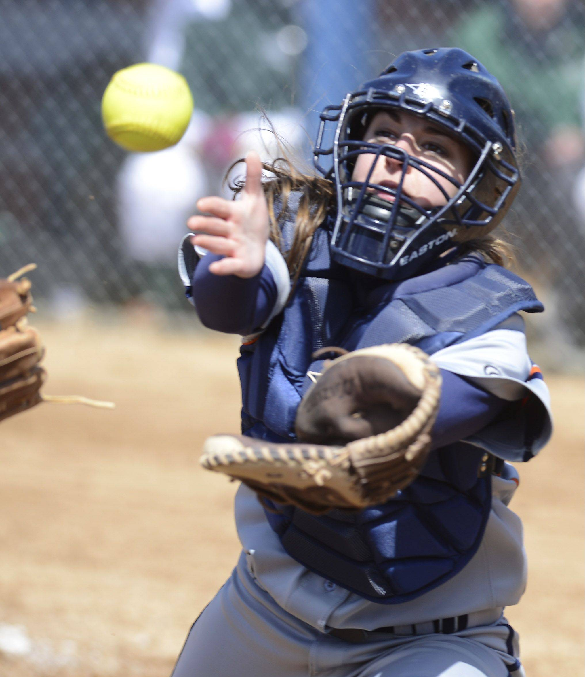 Buffalo Grove catcher Amanda Salzman closes in on a foul pop off an Elk Grove bunt attempt that wound up being caught by third baseman Erin Barton Saturday.