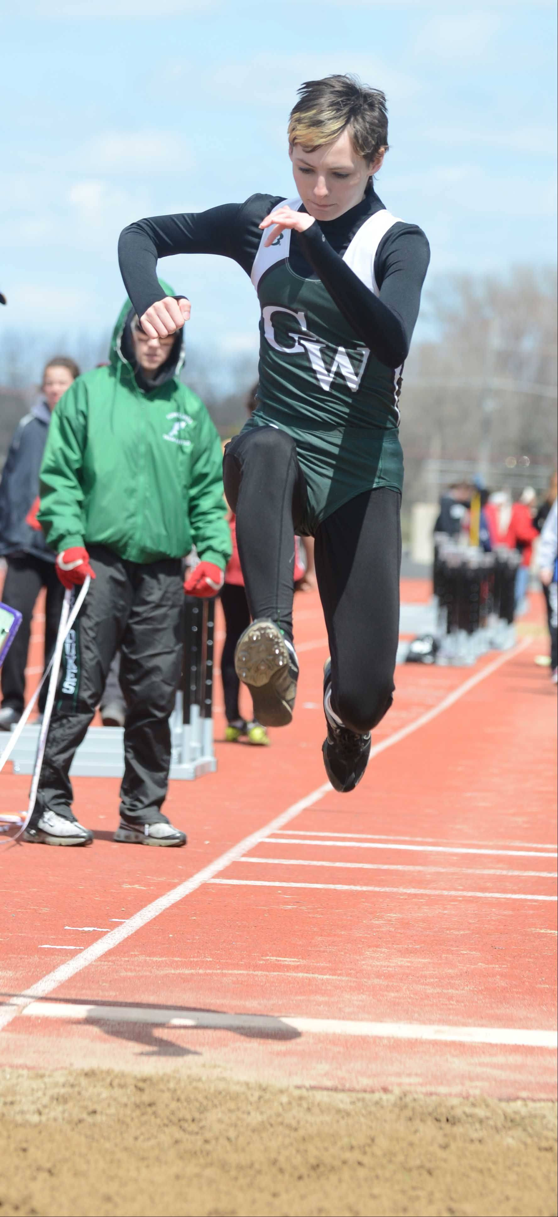 Cynthia Mote of Glenbard West launches during the triple jump during the Sue Pariseau girls track invitational hosted by Glenbard West Saturday.