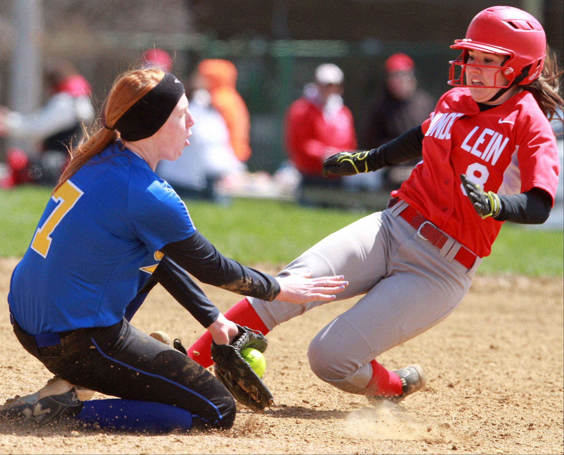 Mundelein�s Maddie Zazas slides safely into second base past Johnsburg�s Carly Wilson at Mundelein on Saturday.