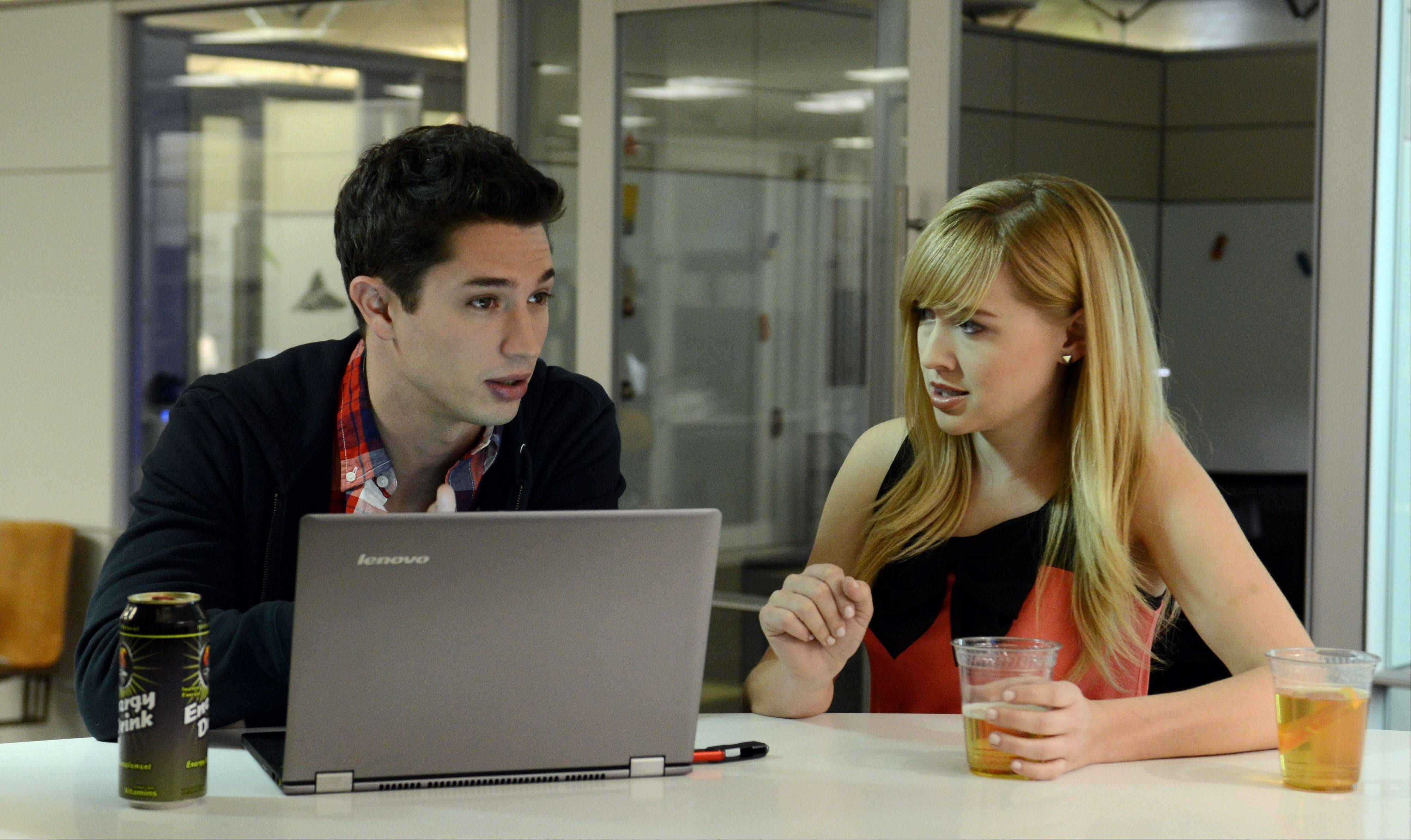 This undated image provided by Amazon shows actors Joe Dinicol, left, and Sarah Stouffer act out a scene from an episode of �Betas,� one of 14 TV show pilots being made by Amazon.com Inc. Amazon is hoping people will sign up to pay $79 a year for an Amazon Prime membership, a free shipping, online video and e-book borrowing service that will include access to the full series on the Web, connected TVs and mobile devices when they're completed.