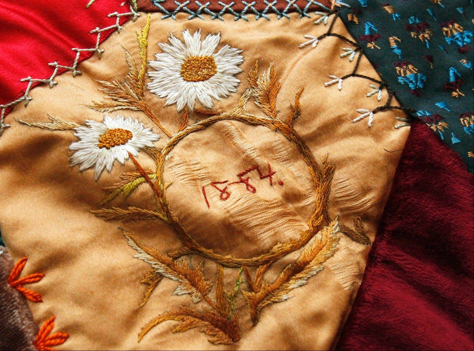 A hand-stitched quilt made by Barney Stickles' grandmother Bertha Hirsch, in 1884 is displayed in Stickles' home.