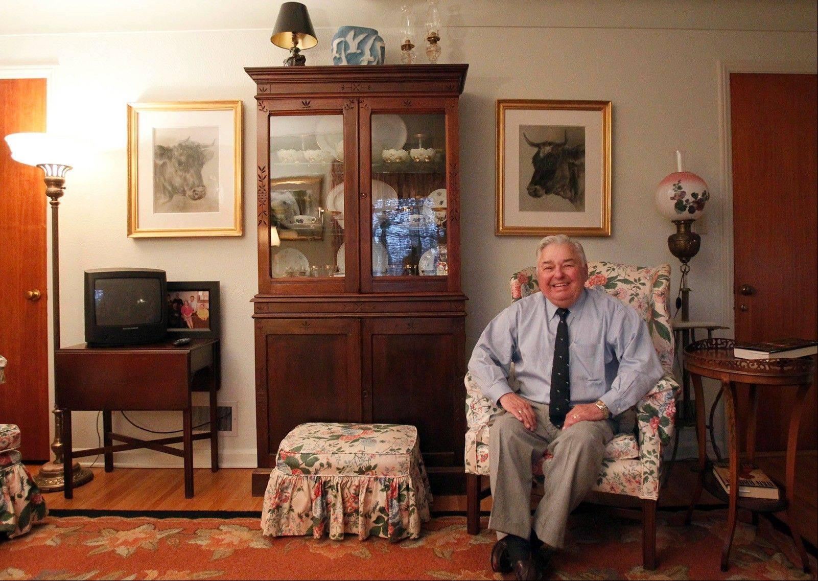 Antiques appraiser Barney Stickles appreciates the 1890 cabinet he displays in his home.