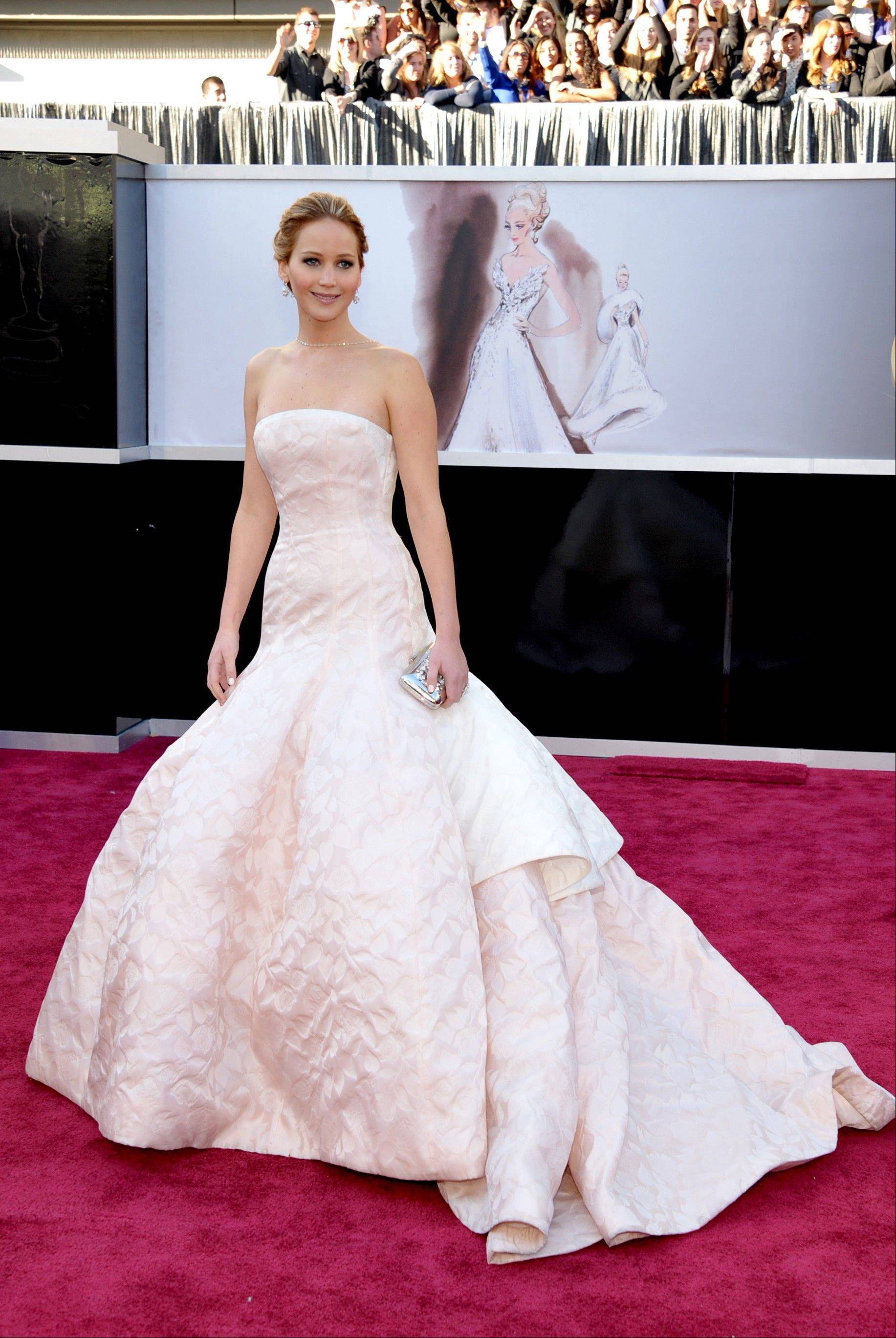 It's likely that this year's parade of fashions will include a few celebrity look-alikes such as this worn by Jennifer Lawrence at the Academy Awards.
