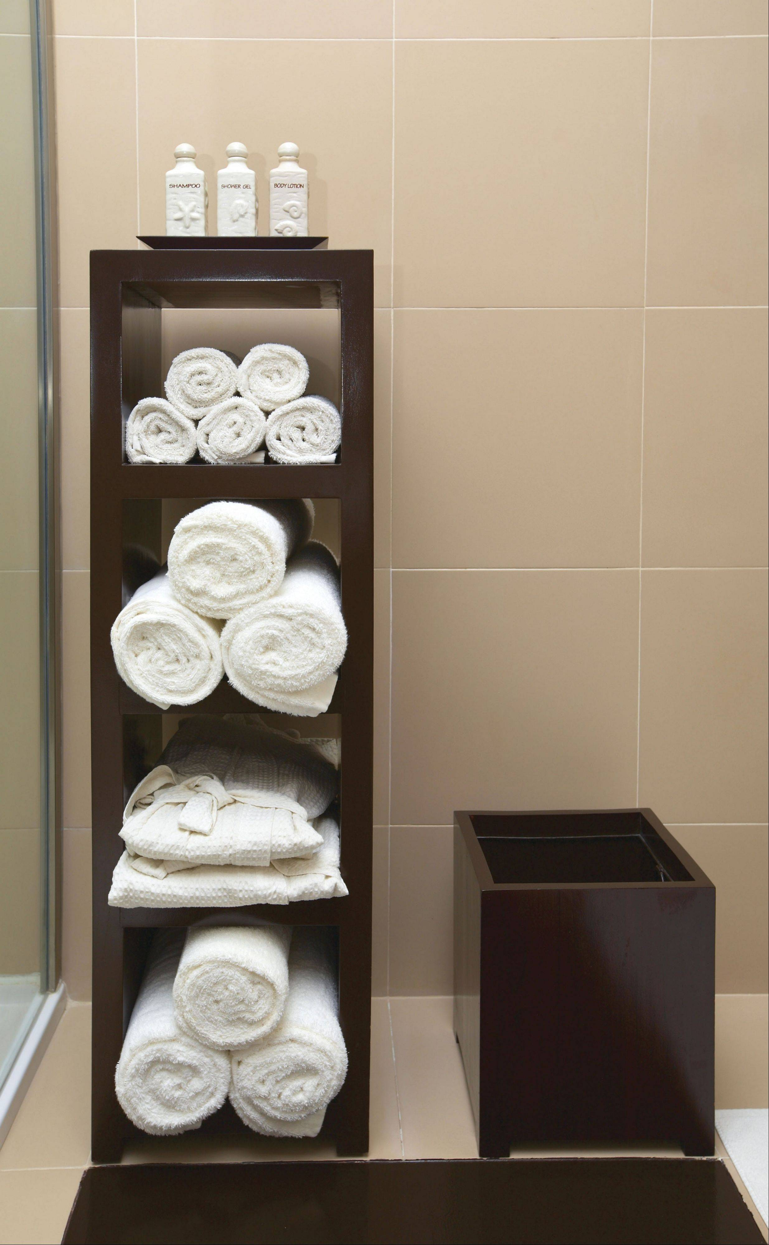 Rolled towels and neatly displayed toiletries cost next to nothing but create a high-end feel.