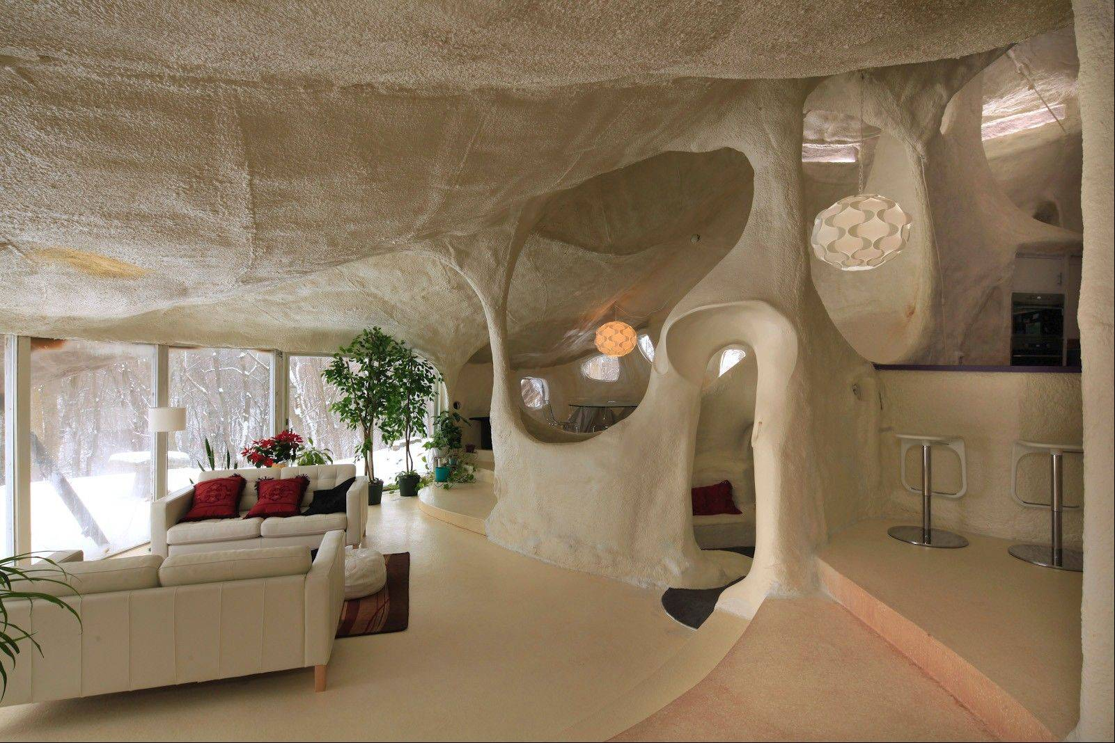The multilevel interior is composed of dips and swirls with different ceiling heights.