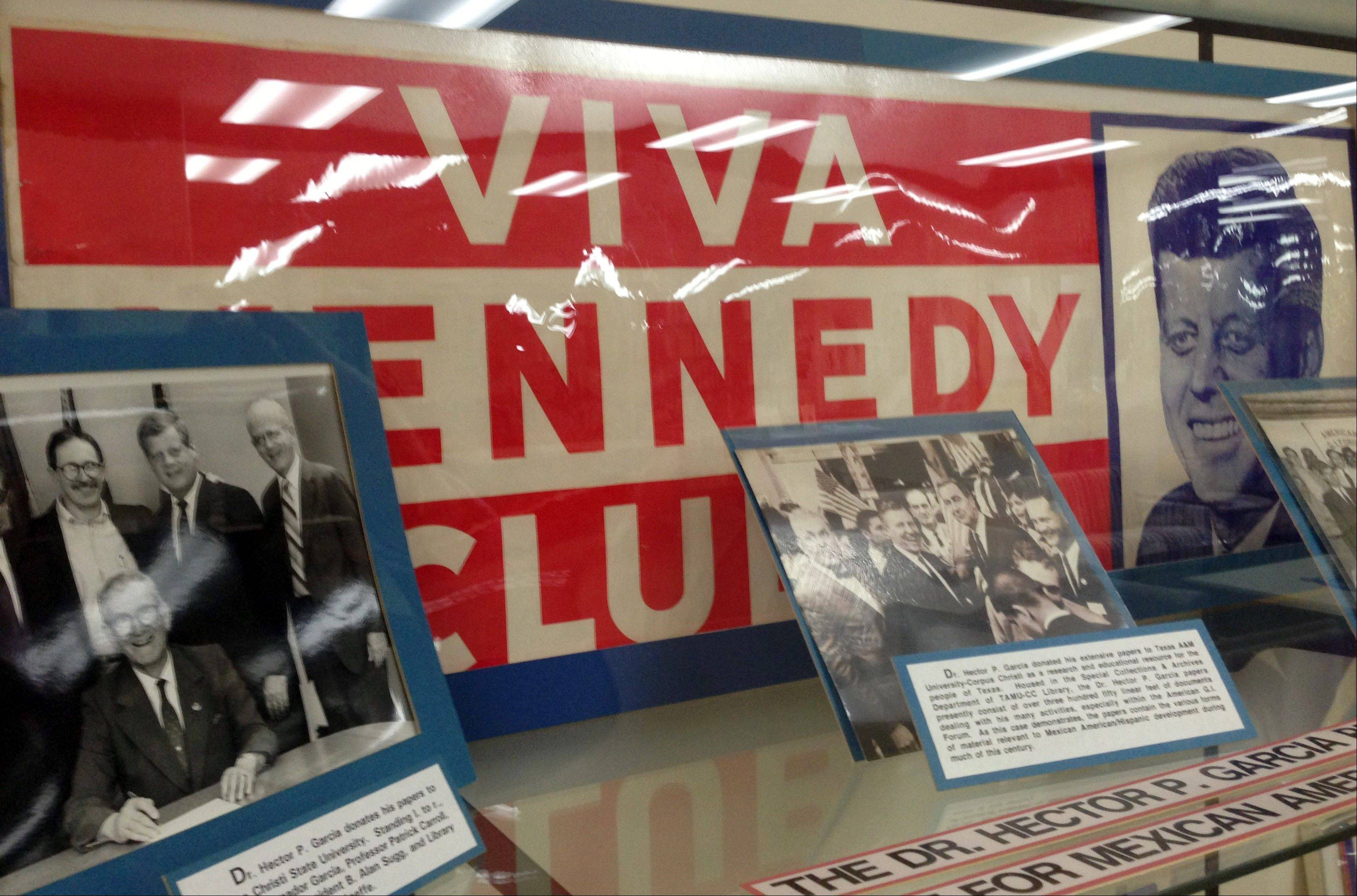 Old Viva Kennedy! campaign buttons of civil rights leader and G.I. Forum founder Dr. Hector P. Garcia, lower left, are on display at the Garcia exhibit at Texas A&M-Corpus Christi.