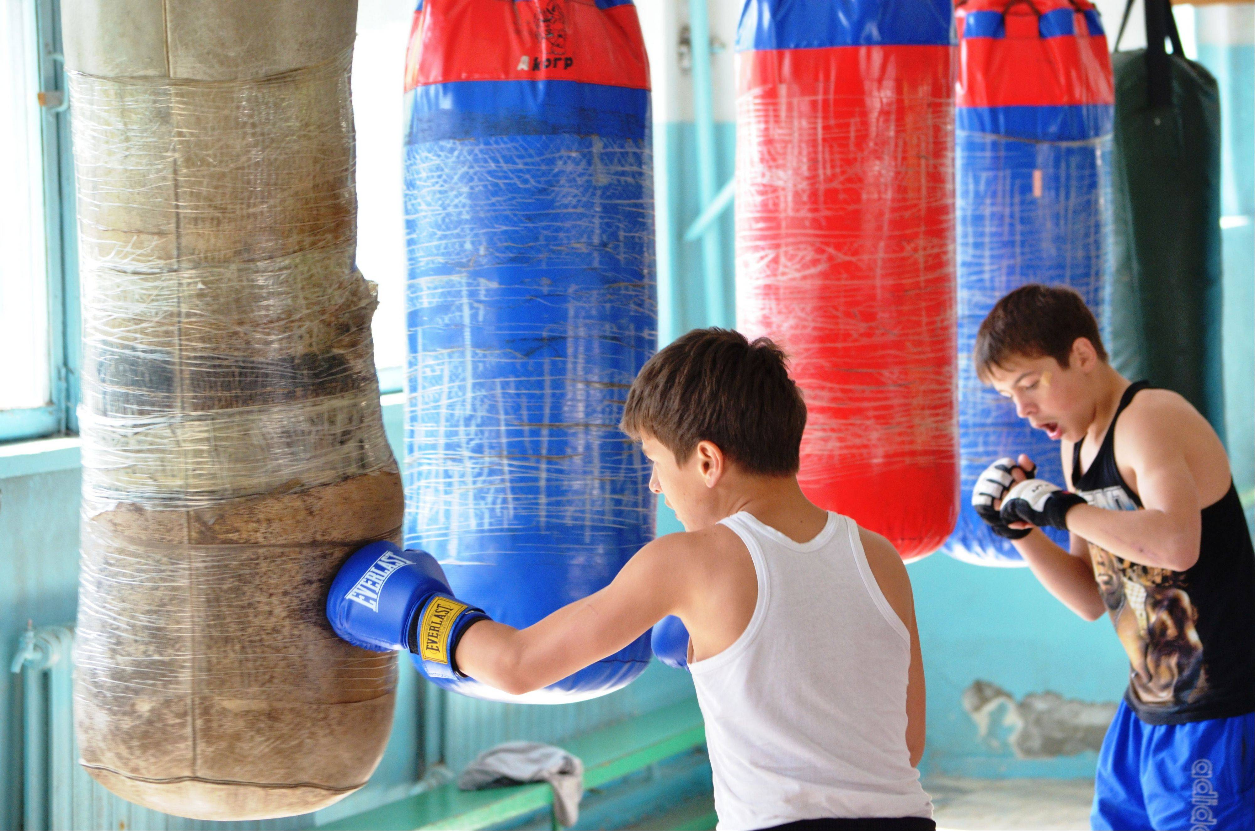 Local boys have boxing training at a sport school where Tamerlan Tsarnaev, who was dubbed a suspect in the Boston Marathon bombings, had his training, in a small Kyrgyz city Tokmok east of the country's capital of Bishkek, on Friday.