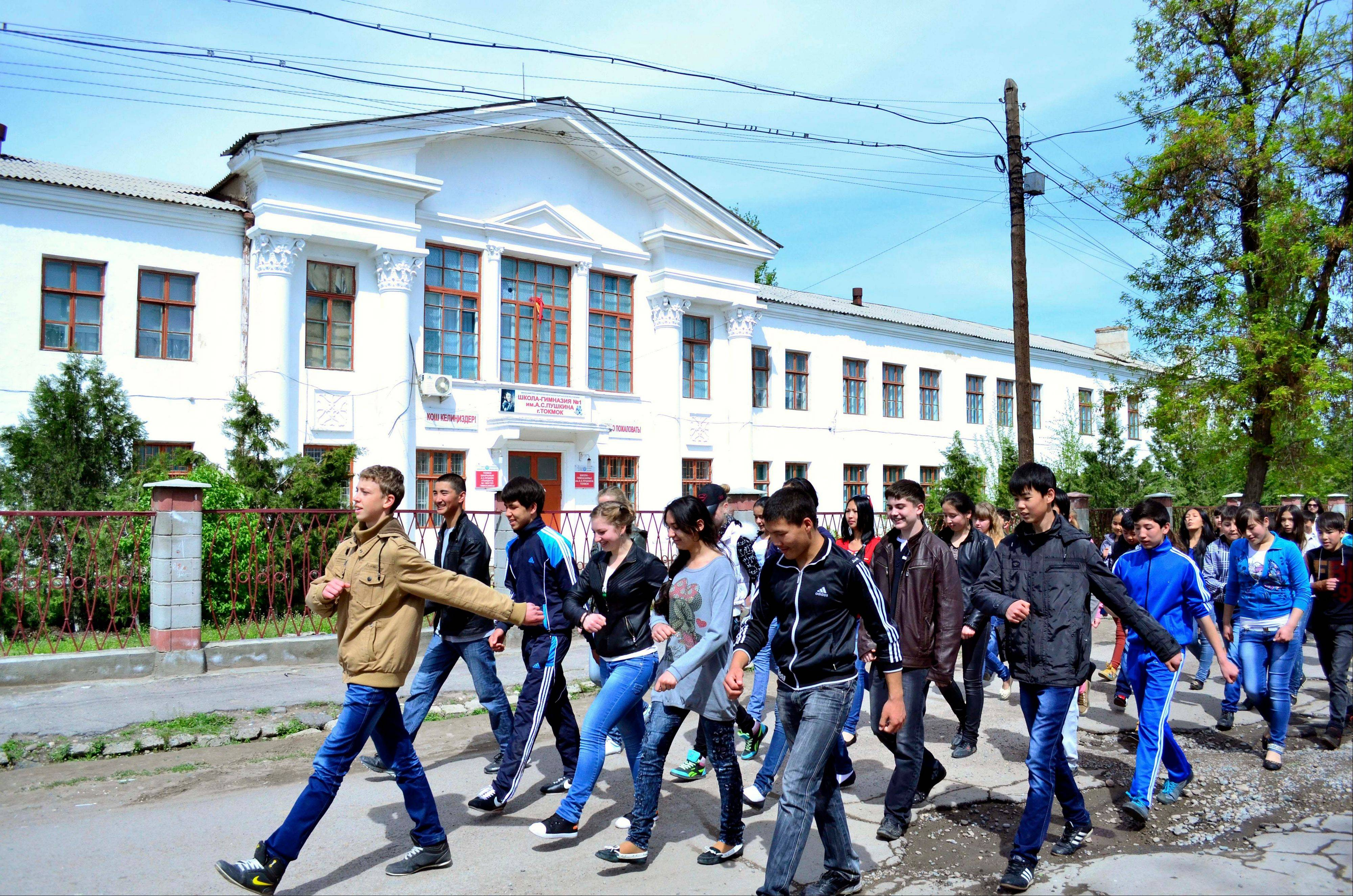 Schoolchildren march in front of a school where Tamerlan Tsarnaev, who was dubbed a suspect in the Boston Marathon bombings, studied, in a small Kyrgyz city Tokmok east of the country's capital of Bishkek, on Friday. Tamerlan Tsarnaev was an amateur boxer with muscular arms and enough brio to arrive at a sparring session without protective gear.