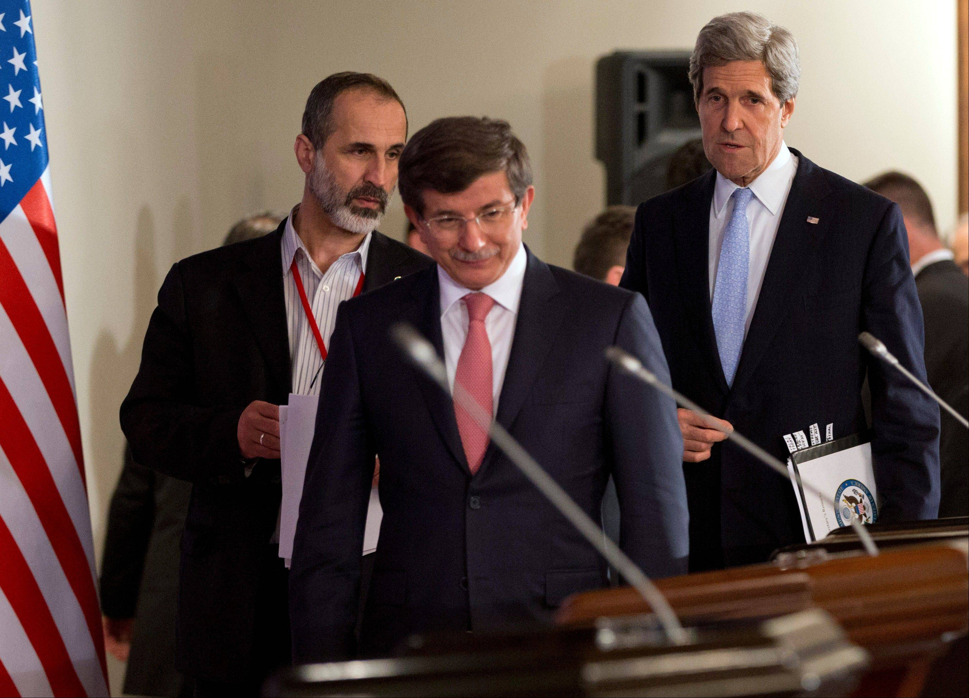 "U.S. Secretary of State John Kerry, right, arrives for a news conference with Turkish Foreign Minister Ahmet Davutoglu, center, and Syrian opposition leader Moaz al-Khatib after a ""Friends of Syria"" group meeting at the Adile Sultan Palace on Sunday, April 21, 2013, in Istanbul, Turkey."