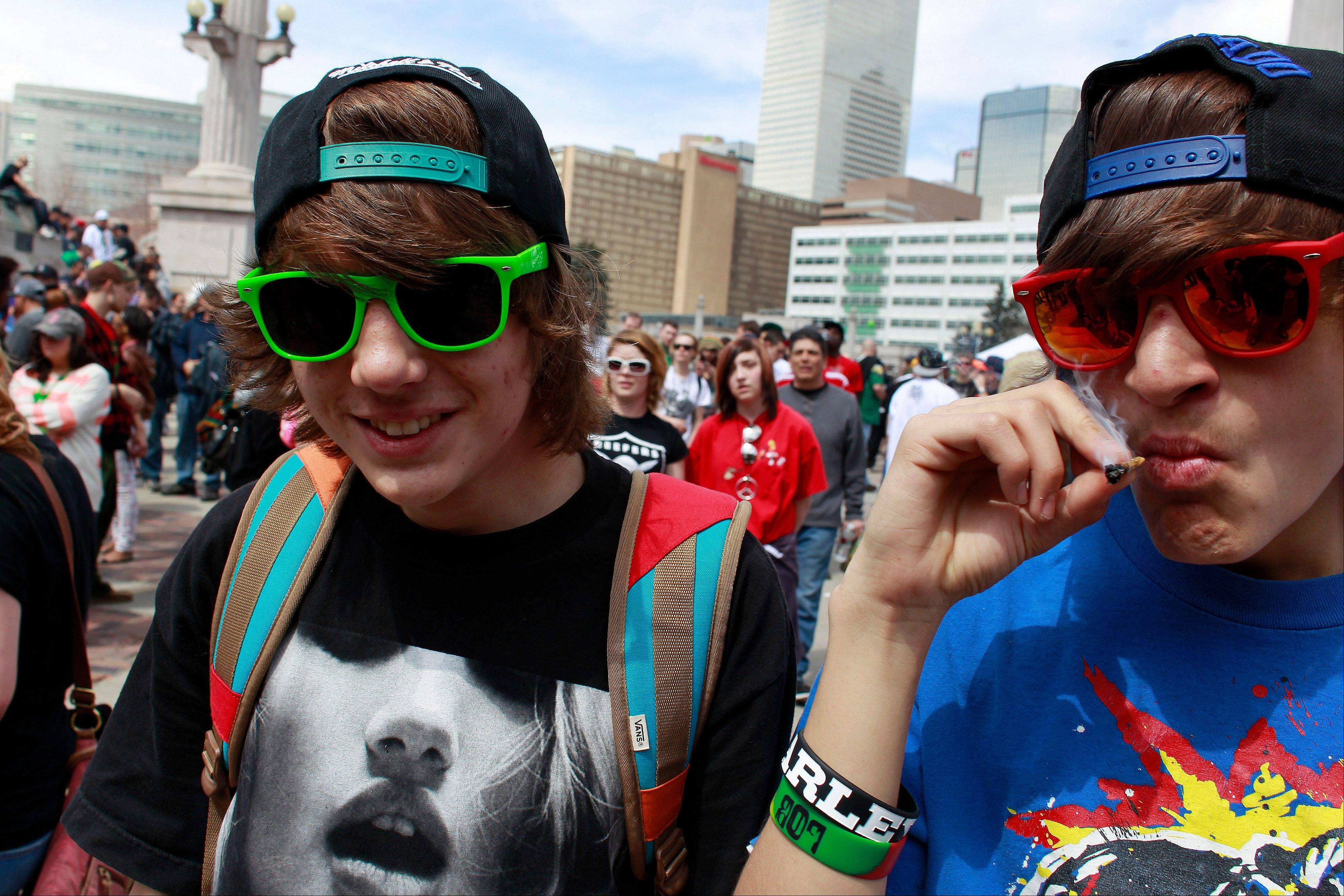 Youths smoke marijuana Saturday at the Denver 4/20 pro-marijuana rally at Civic Center Park in Denver.