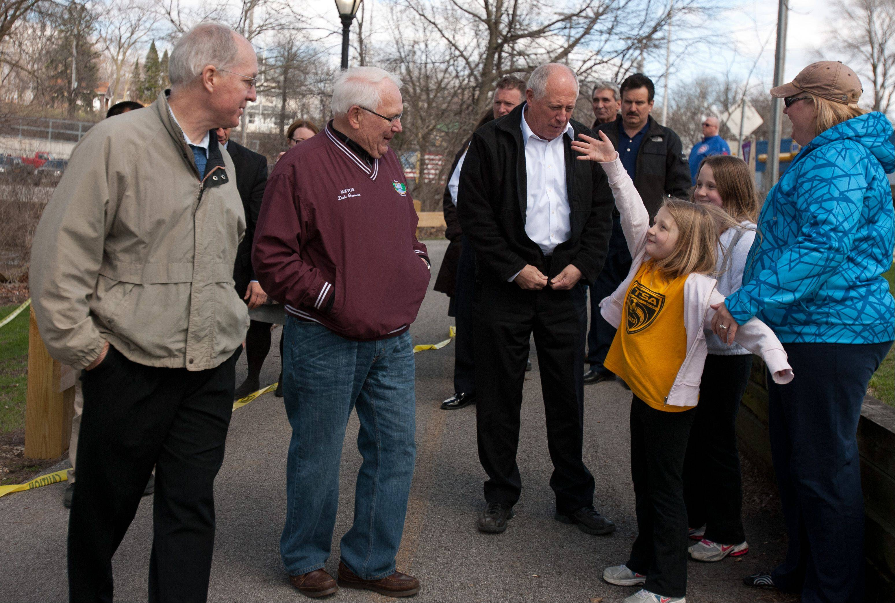 Gov. Pat Quinn addresses flooding concerns throughout the state, before a press conference along the Fox River in North Aurora. U.S Rep. Bill Foster, left, and North Aurora Village President Dale Berman, center, attended the event.
