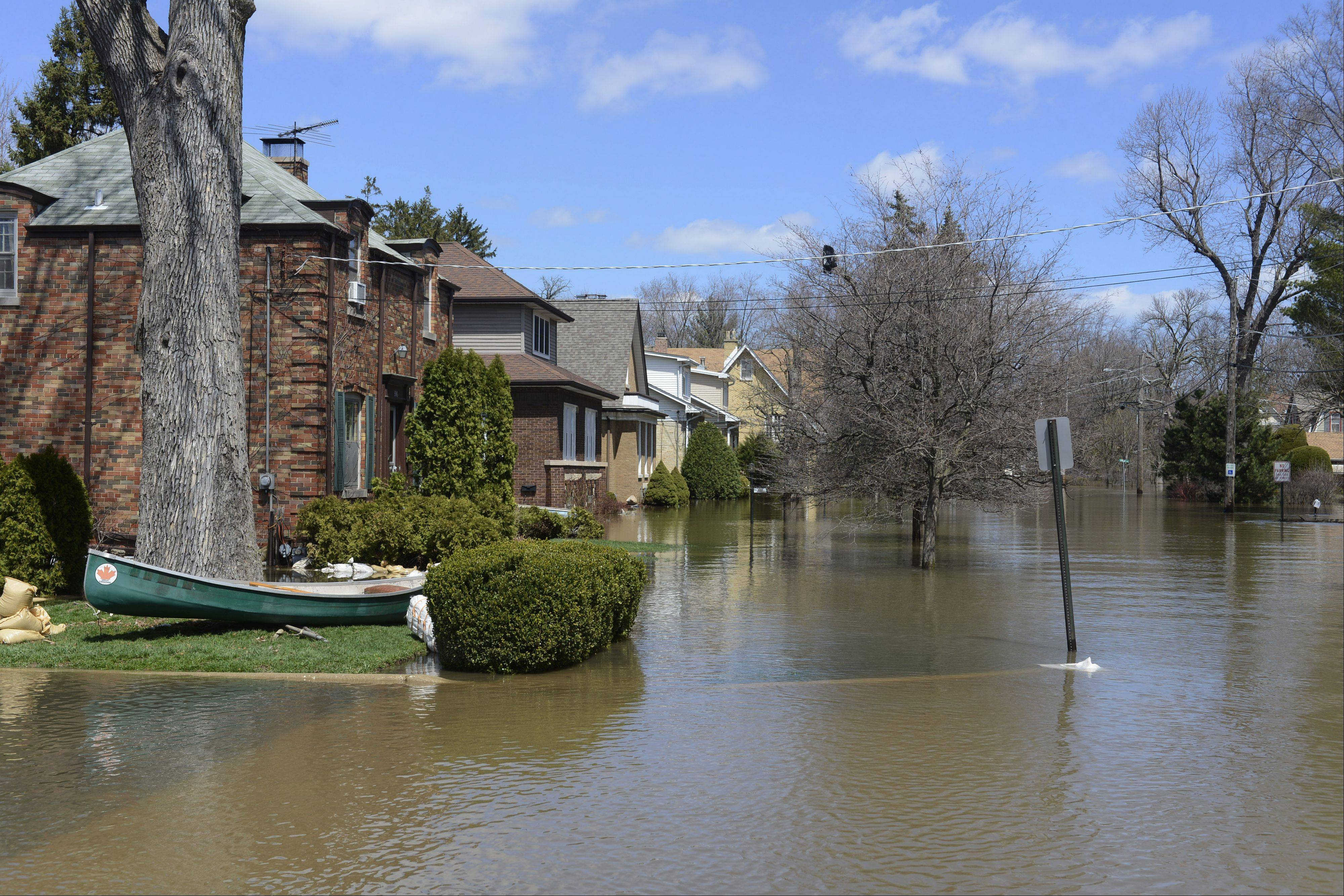 Hawthorne Lane is among the streets near the flooded Des Plaines River that remains underwater in Des Plaines Saturday.