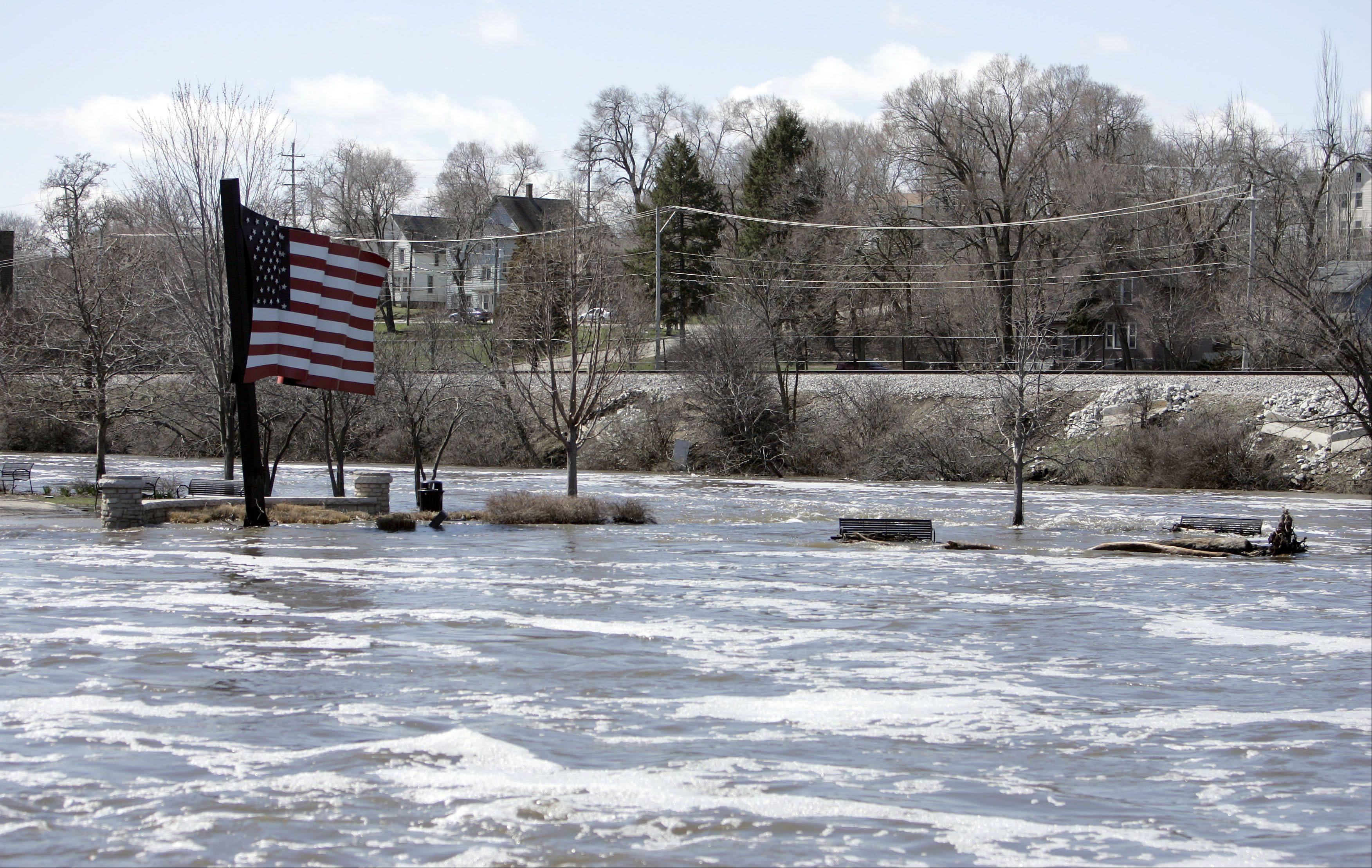 Most of Walton Island is covered by the Fox River which continues to overflow its' banks Saturday.