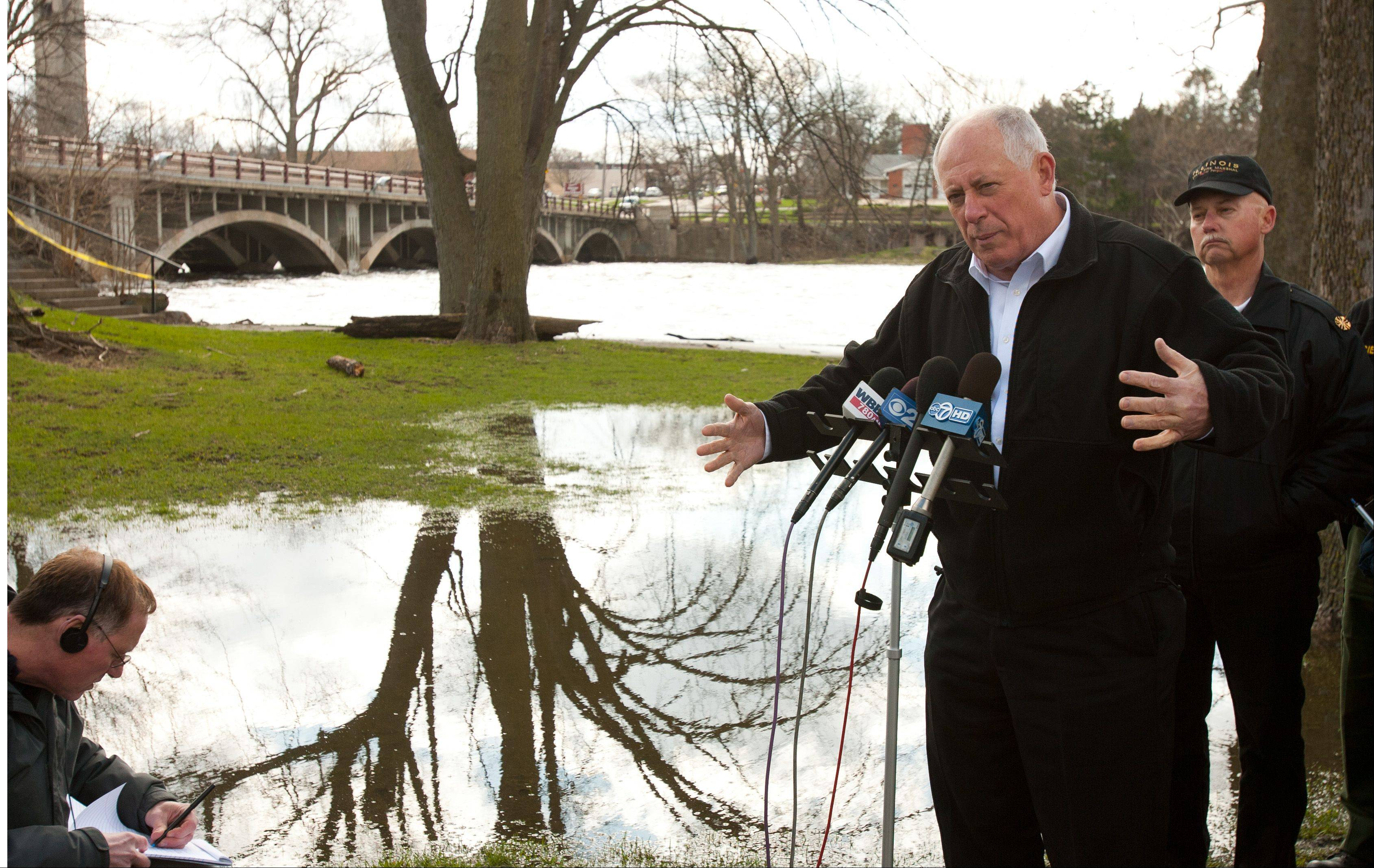 Gov. Pat Quinn addresses flooding concerns throughout the state during a news conference Saturday along the Fox River in North Aurora.