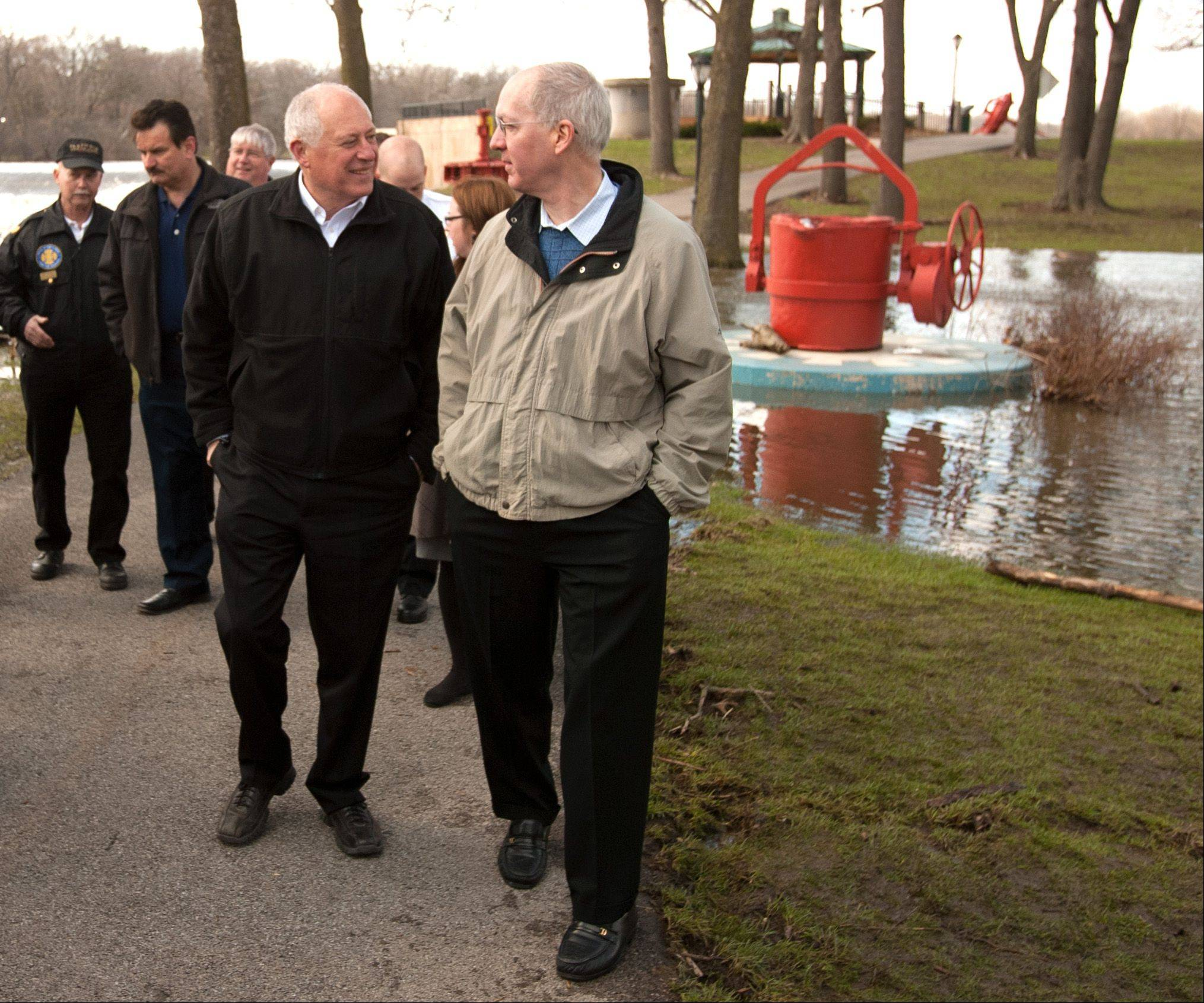 Gov. Pat Quinn addresses flooding concerns throughout the state following a news conference Saturday along the Fox River in North Aurora. He asked for U.S. Rep. Bill Foster's help in Washington.