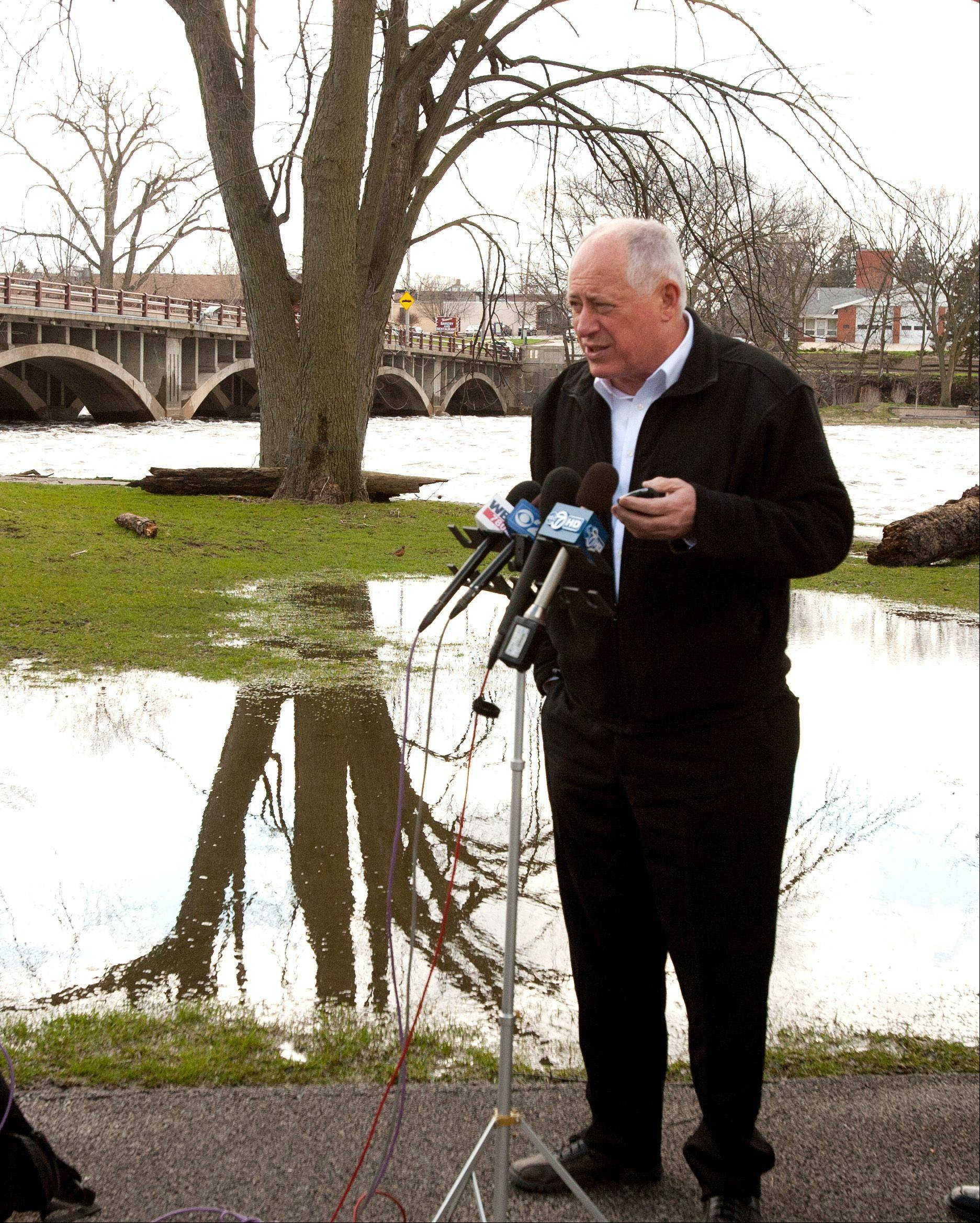 Gov. Pat Quinn addresses flooding concerns throughout the state, during a news conference Saturday along the Fox River in North Aurora.