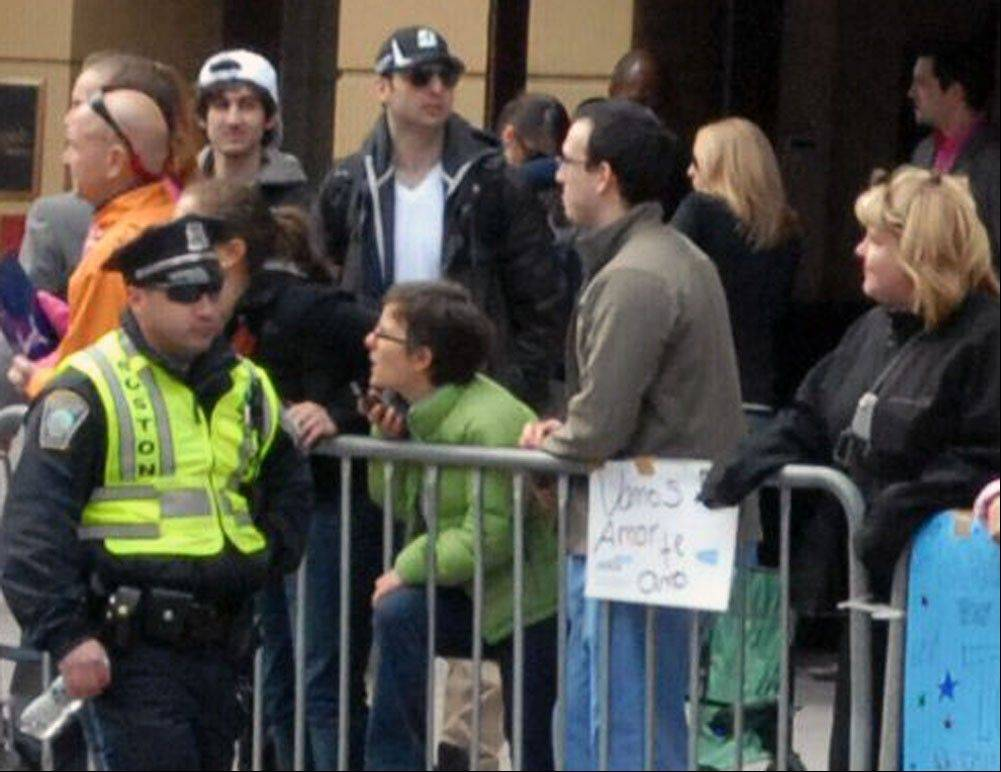 This Monday, April 15, 2013 photo provided by Bob Leonard shows second from left, Tamerlan Tsarnaev, who was dubbed Suspect No. 1 and third from left, Dzhokhar A. Tsarnaev, who was dubbed Suspect No. 2 in the Boston Marathon bombings by law enforcement. This image was taken approximately 10-20 minutes before the blast.