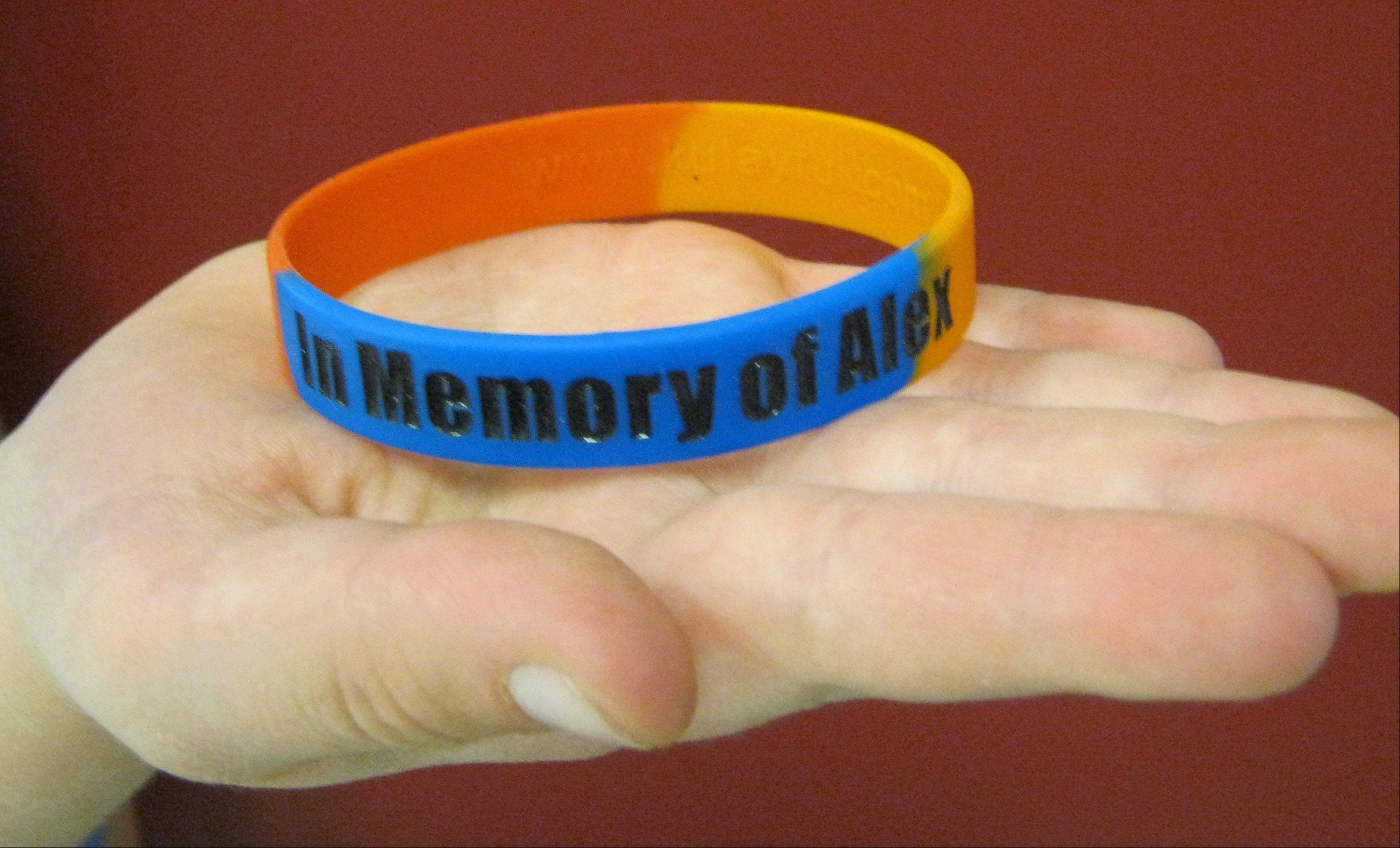 The memorial wristbands are red, orange and blue -- Alex Lancaster's favorite colors. The bands sell for $3 each.