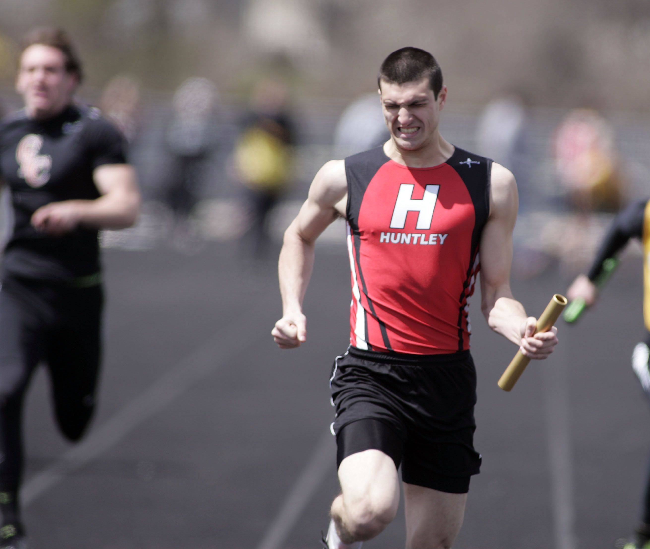 Huntley's Mike Dollar pulls ahead during the last leg of the 400-meter relay during the McHenry County boys and girls track meet Saturday at Cary-Grove High School in Cary.