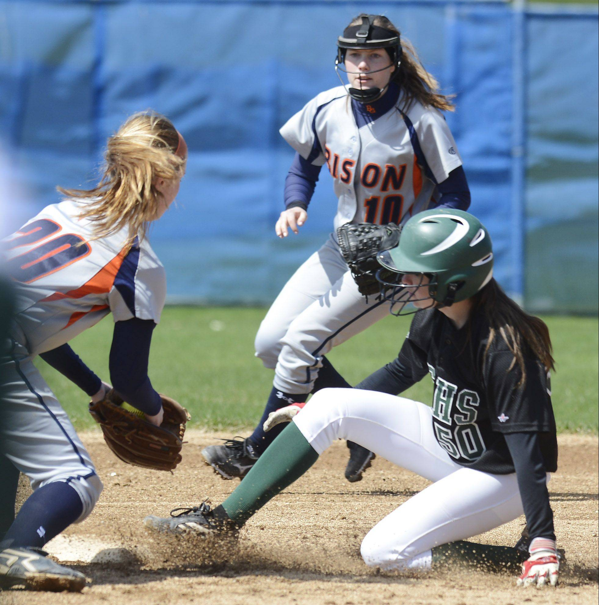 Elk Grove's Abbey Sloan slides safely into second base on a steal ahead of the tag by Buffalo Grove shortstop Dea Barton as second baseman Maddi Morini backs up the play Saturday.