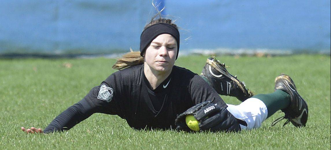 Elk Grove right fielder Brianna Leach makes a diving catch against Buffalo Grove during Saturday's game.