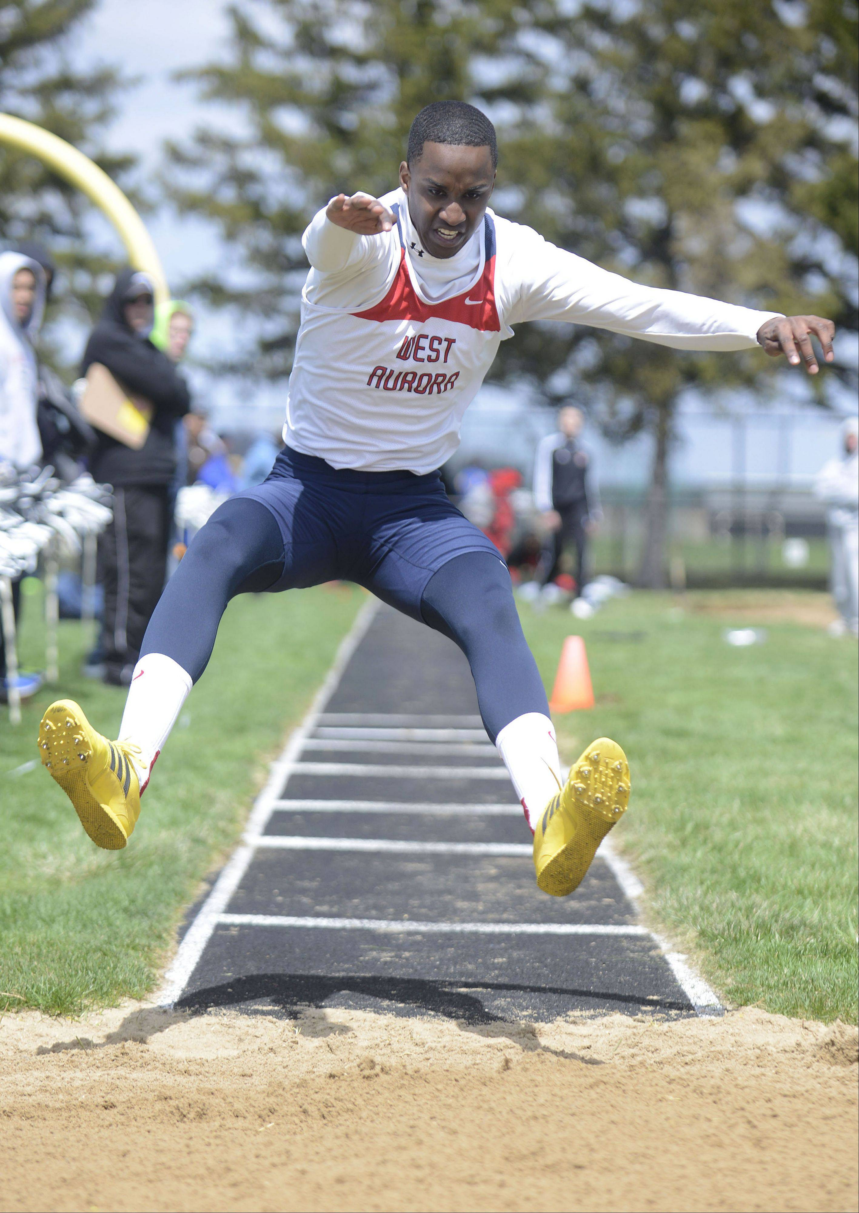 West Aurora's Aaron Kennebrew in the triple jump at the Kaneland meet on Saturday, April 20.