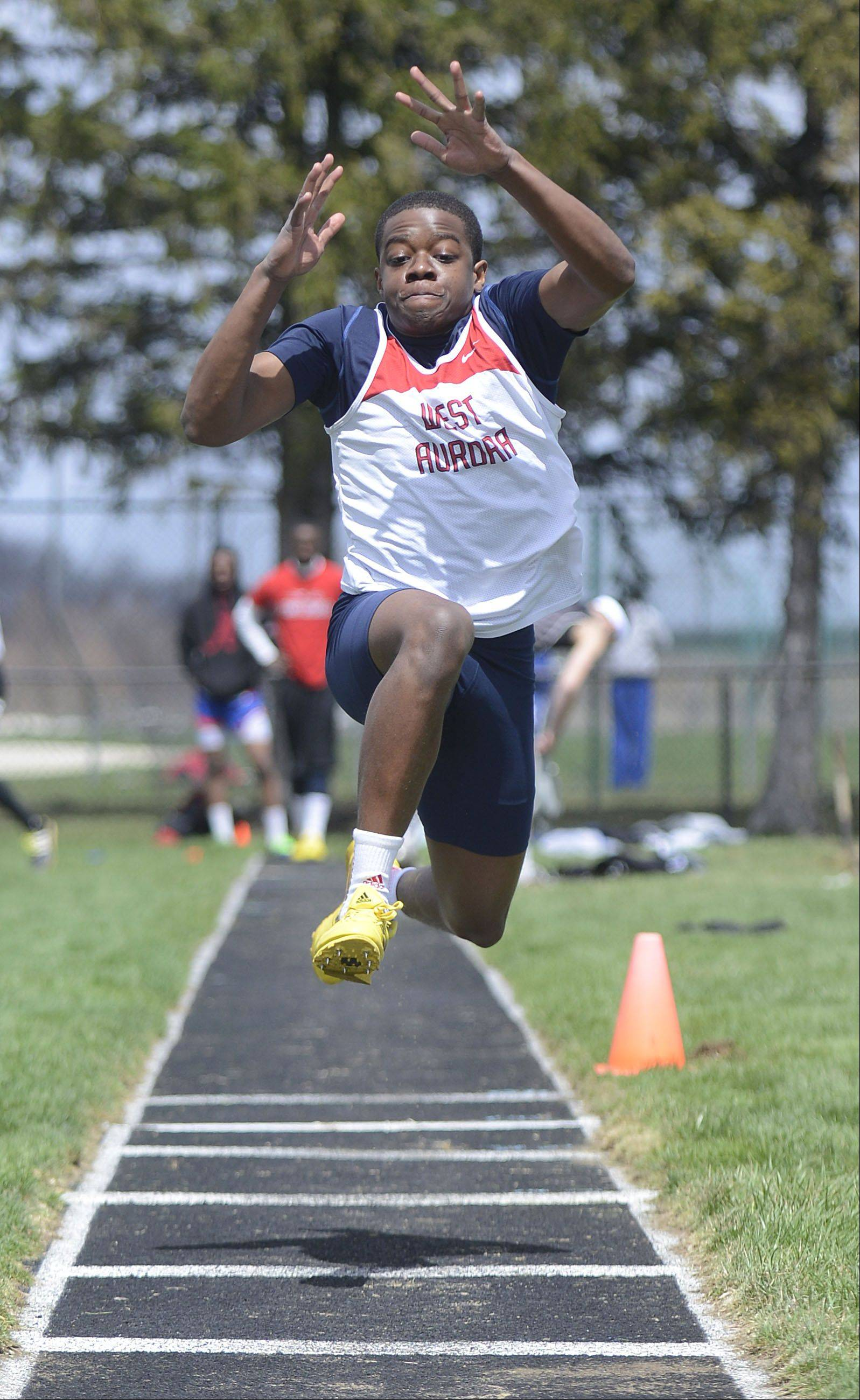 West Aurora's Charles House in the triple jump at the Kaneland meet on Saturday, April 20.