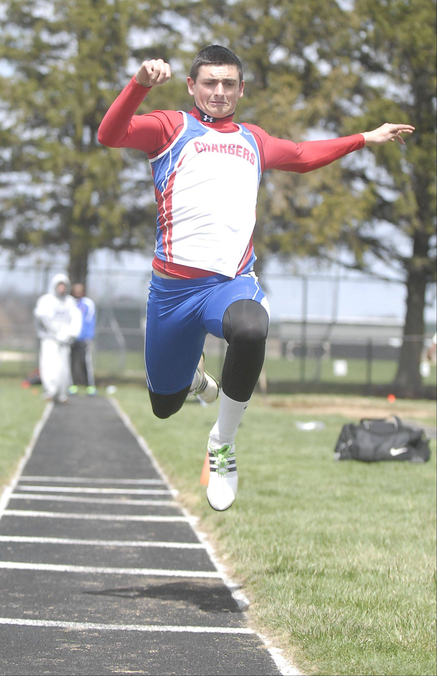 Dundee-Crown's RJ Schmidt in the triple jump finals at the Kaneland meet on Saturday, April 20.