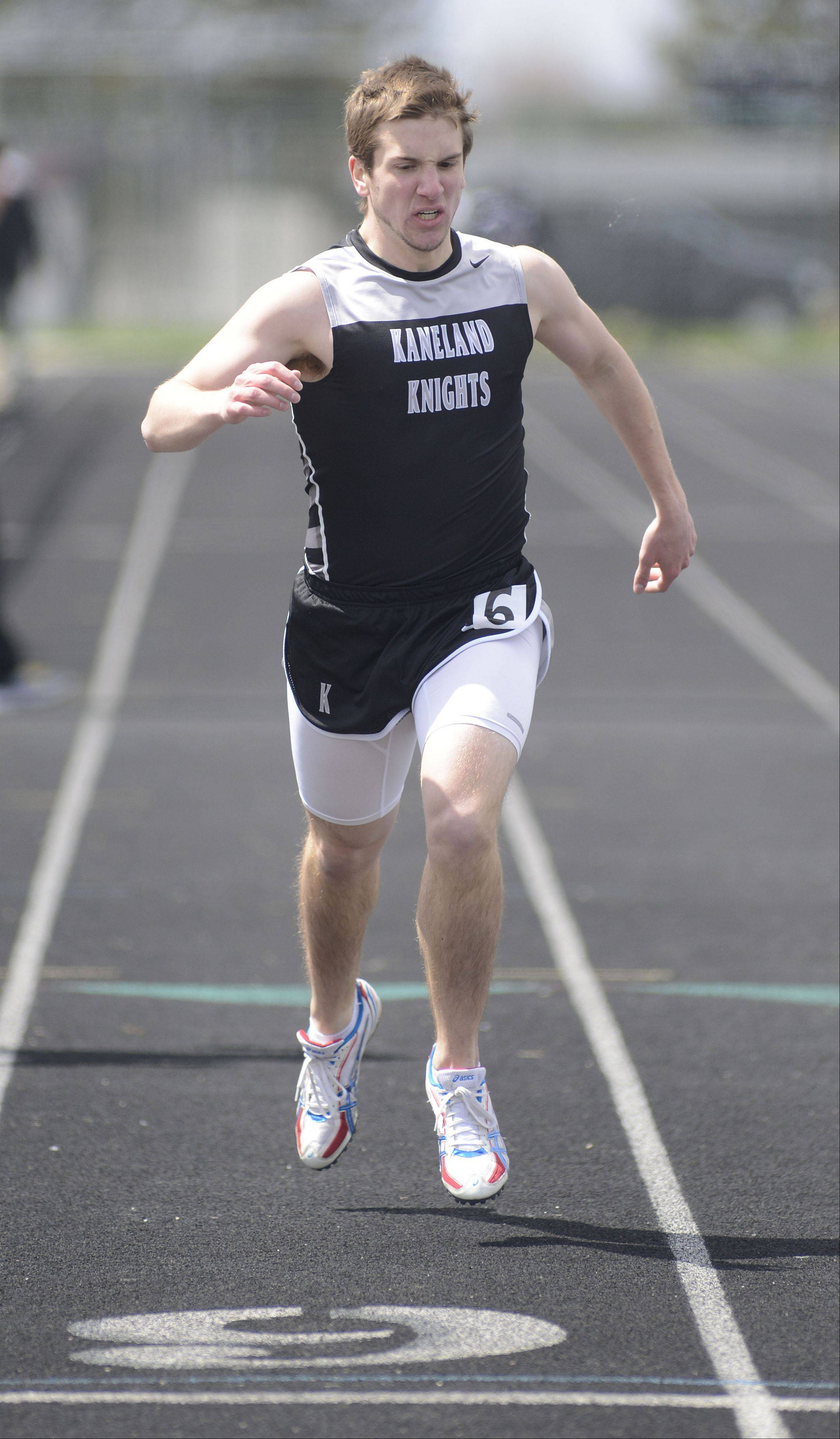 Kaneland's Brad Kigyos in the third heat of the 400 meter dash at Kaneland meet on Saturday, April 20.