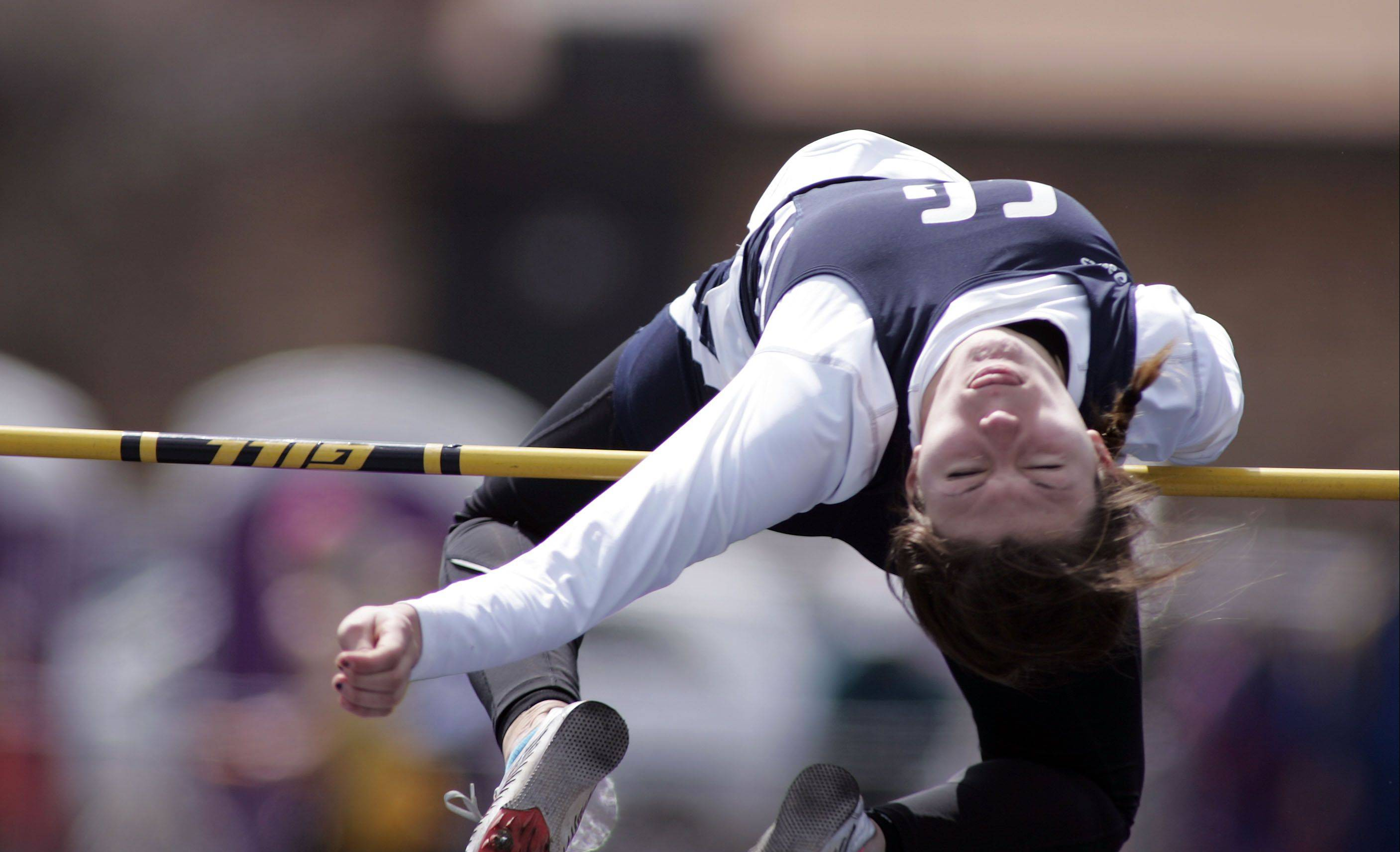 Cary-Grove's Erika Sternard launches herself into the air as she competes in the high jump during the McHenry County boys and girls track meet Saturday at Cary-Grove High School in Cary.