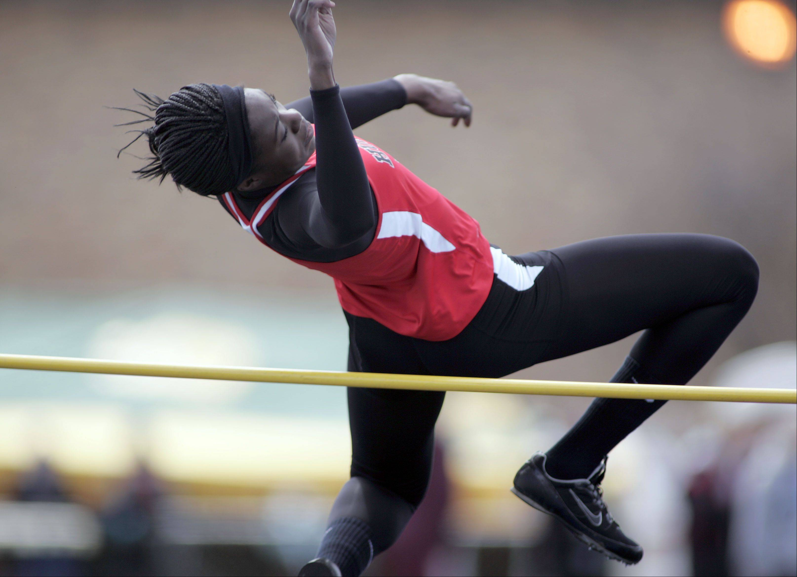 Huntley's Omo Tseumah, launches herself into the air as she competes in the high jump during the McHenry County boys and girls track meet Saturday at Cary-Grove High School in Cary.