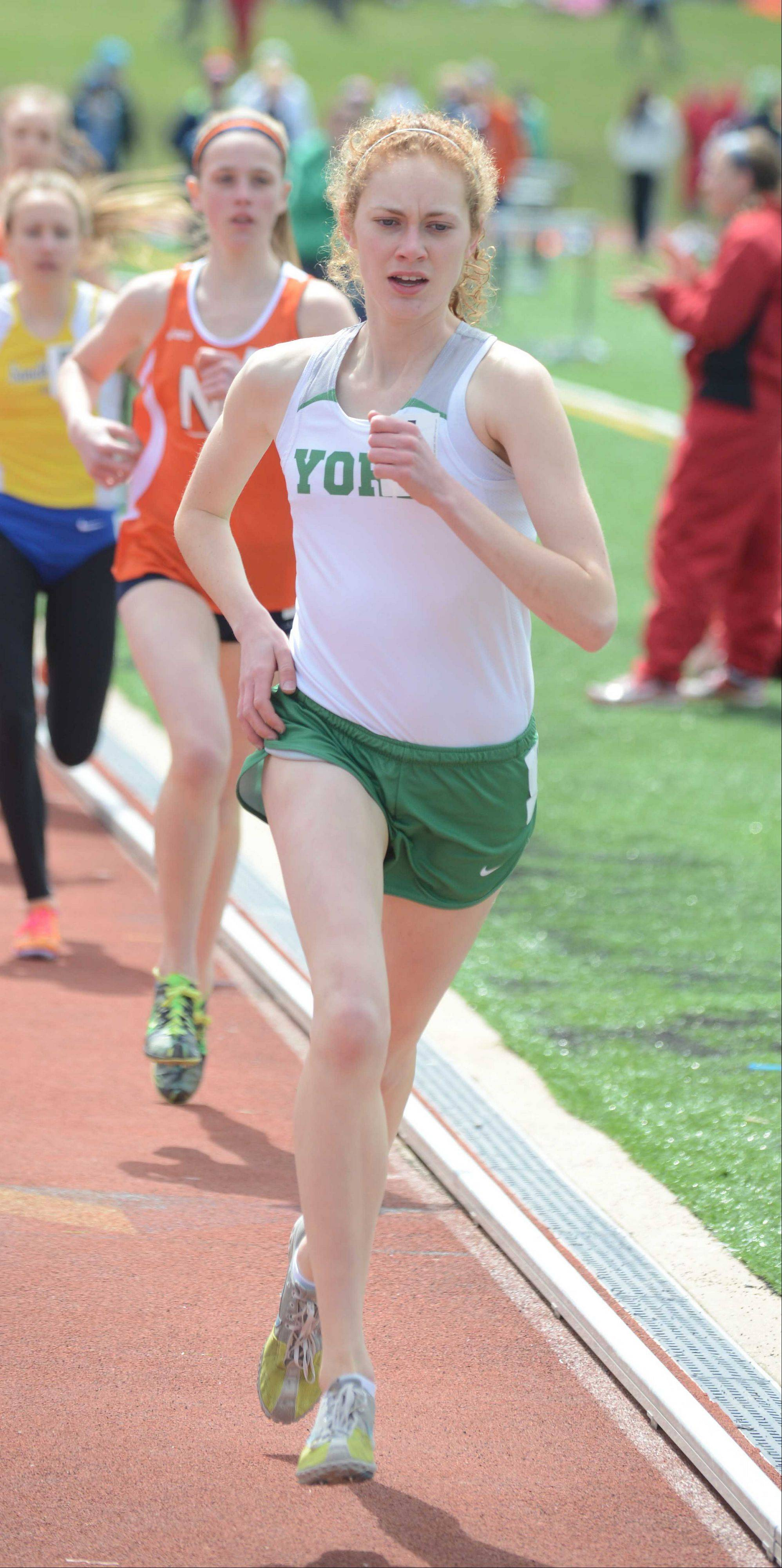 Emma Fisher of York runs in the 3200 during the Sue Pariseau girls track invitational hosted by Glenbard West Saturday.