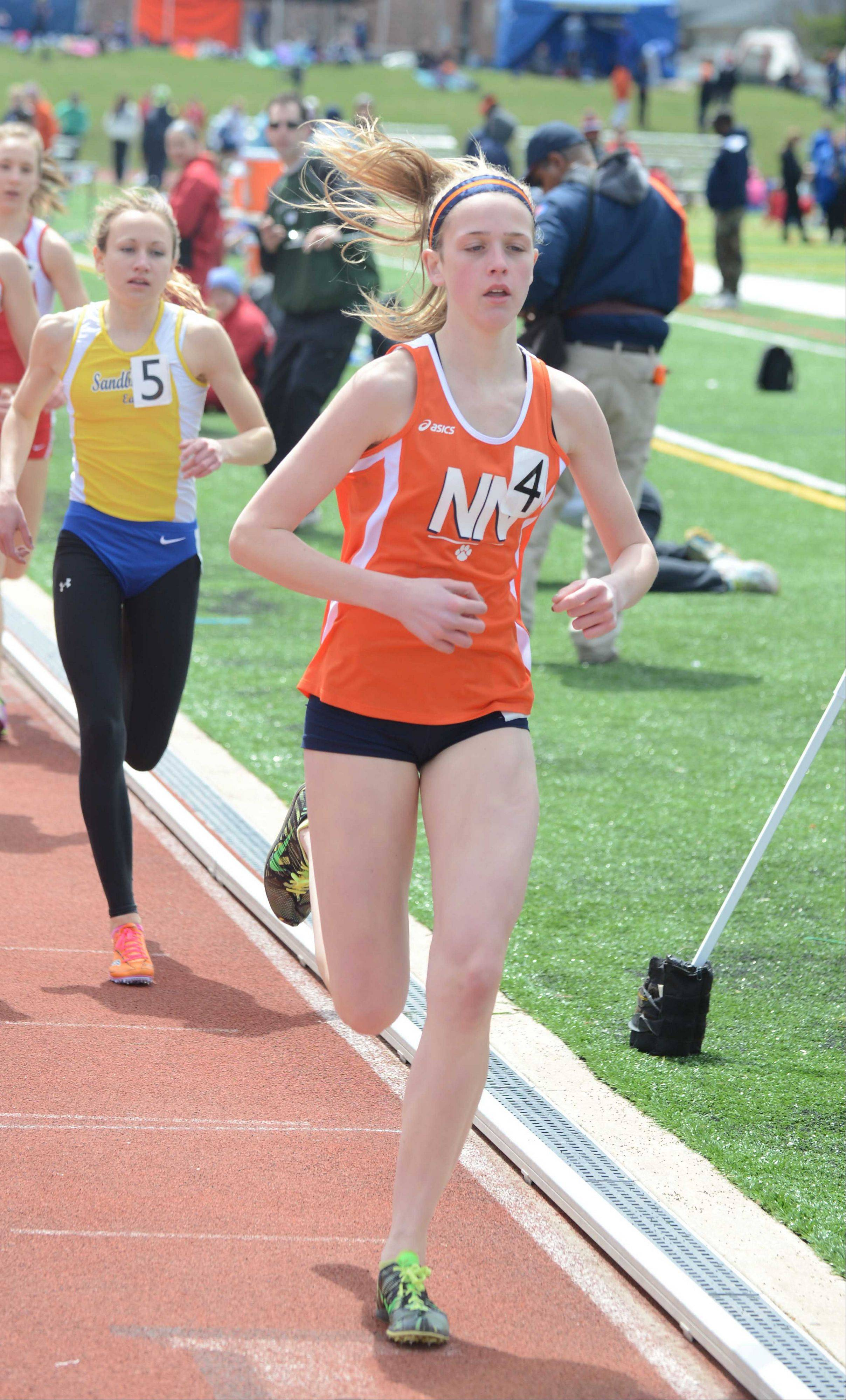EmKelsey Meyer of Naperville North runs in the 3200 during the Sue Pariseau girls track invitational hosted by Glenbard West Saturday.