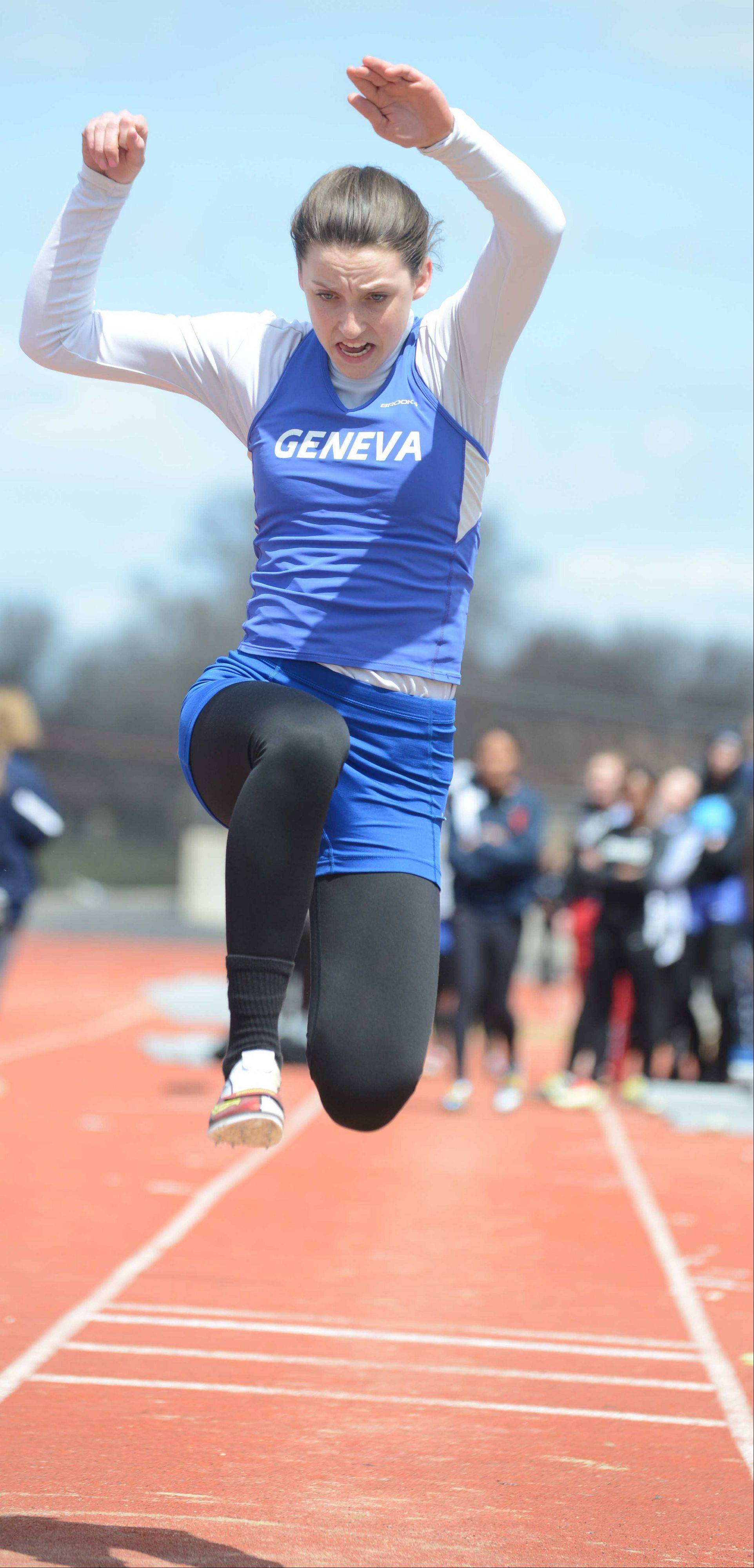 Kate Rogers of Geneva High School launches during the triple jump during the Sue Pariseau girls track invitational hosted by Glenbard West Saturday.