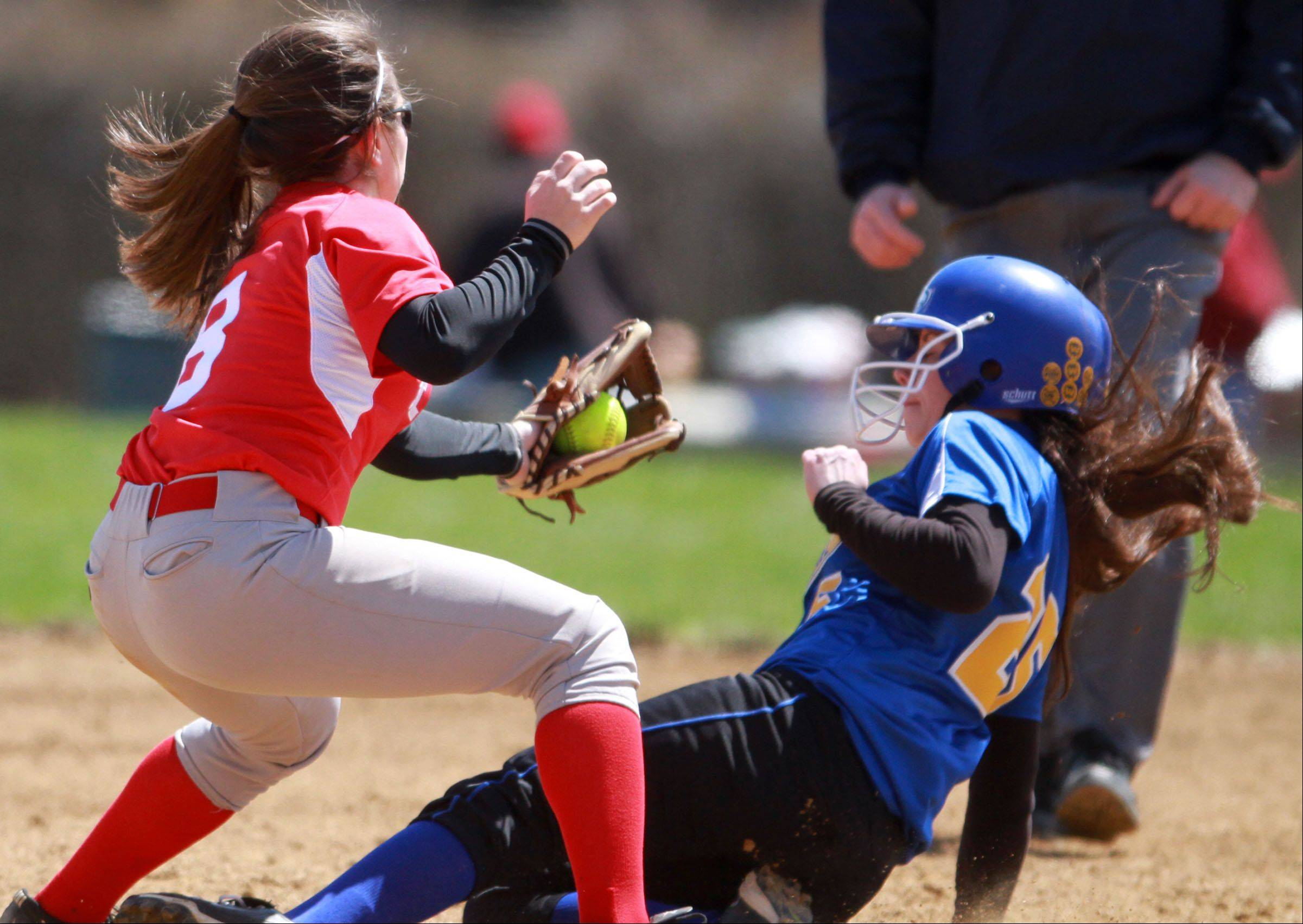 Mundelein's Maddie Zazas has Johnsburg's Kelly Ackermann out at second at Mundelein on Saturday.