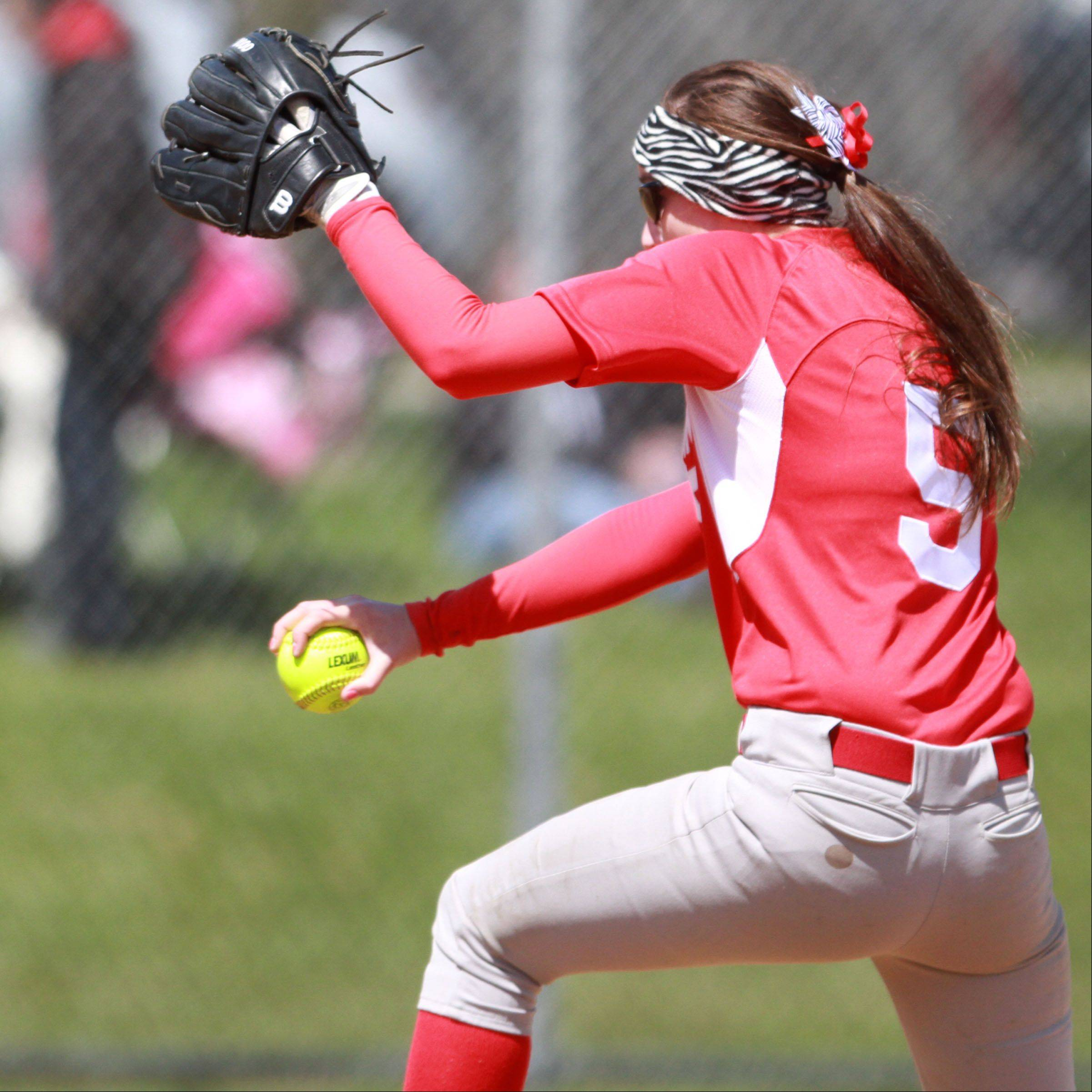 Mundelein's Erin Kennelly pitches against Johnsburg's at Mundelein on Saturday. 3.