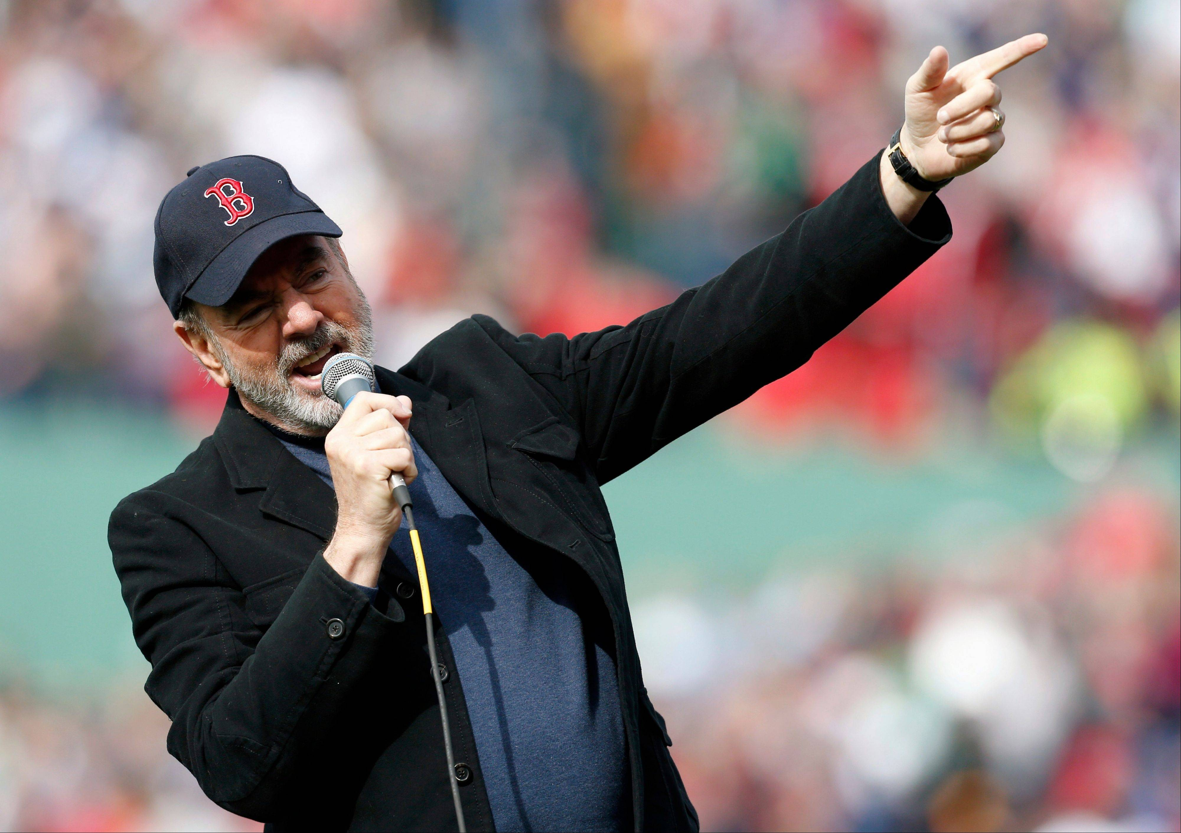 "Neil Diamond sings '""Sweet Caroline"" during the eighth inning of a baseball game between the Boston Red Sox and the Kansas City Royals in Boston, Saturday, April 20, 2013."