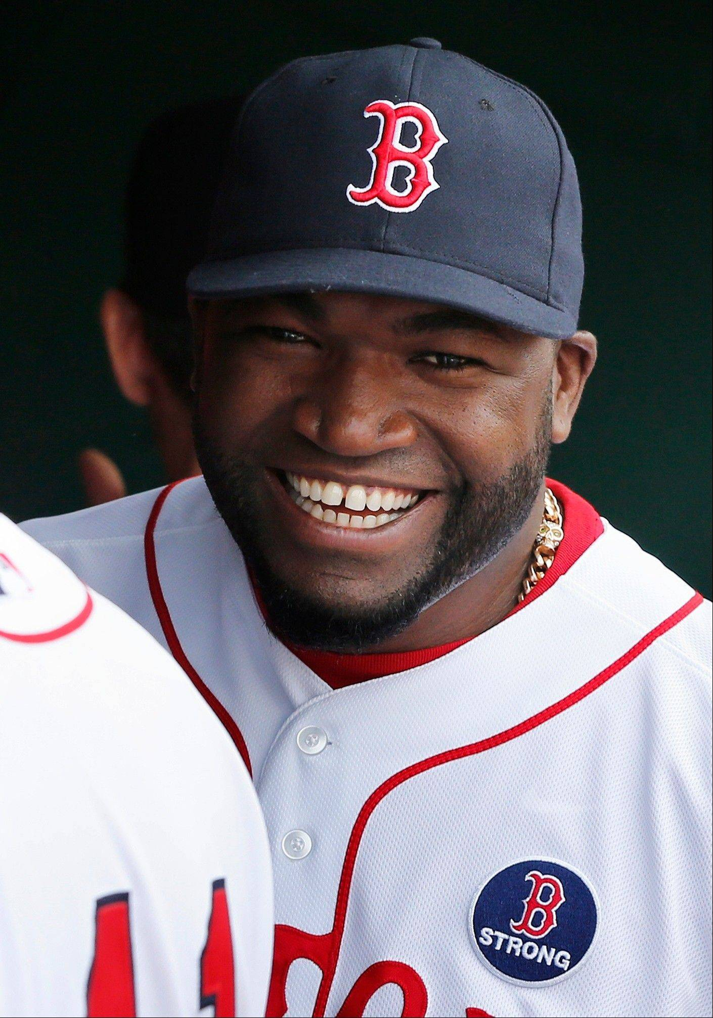 Boston Red Sox's David Ortiz wears a 'B Strong' decal along with the rest of the Red Sox team before a baseball game against the Kansas City Royals in Boston, Saturday, April 20, 2013.