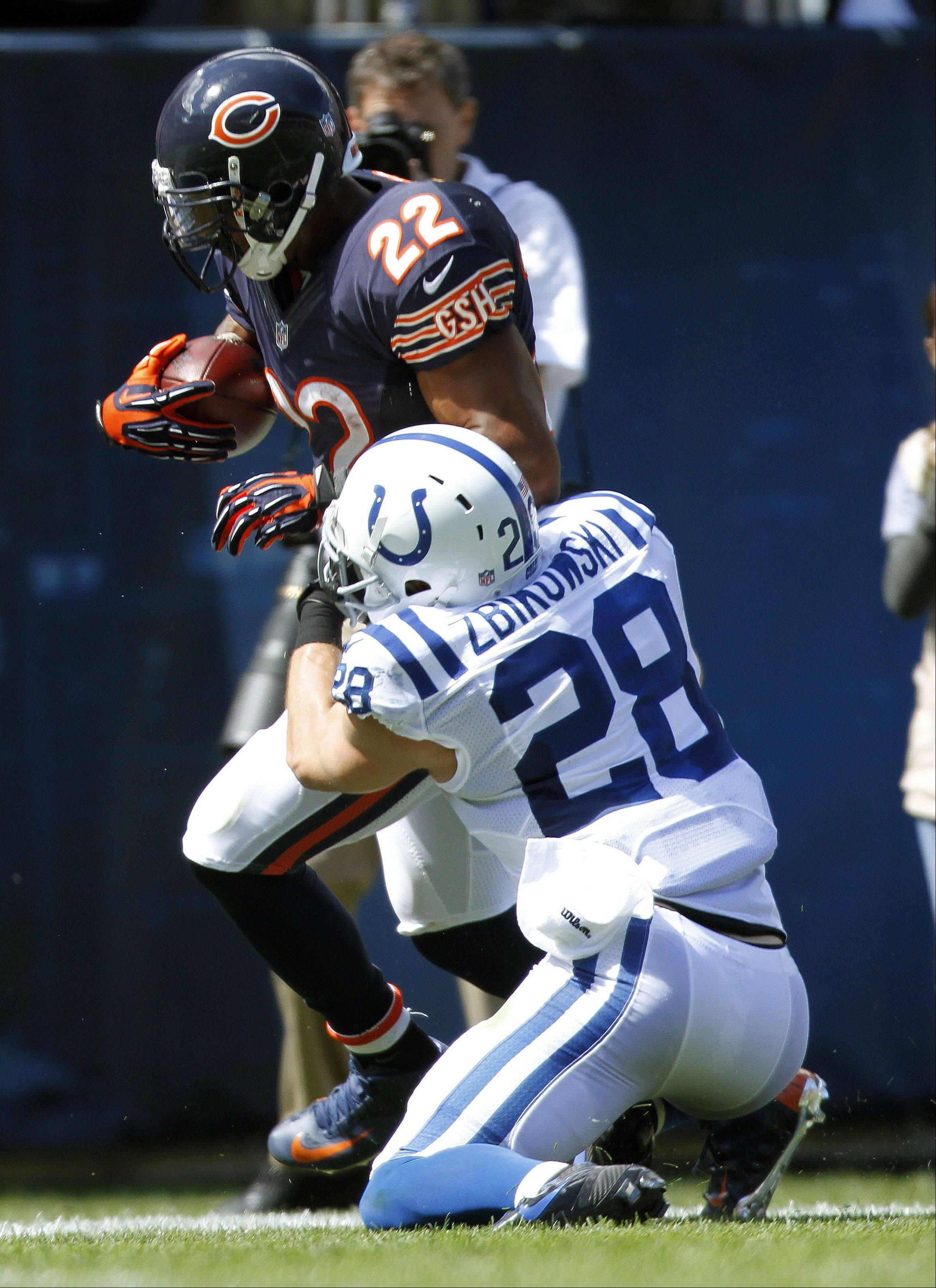 Bears running back Matt Forte tries to break a tackle by Indianapolis Colts defensive back Tom Zbikowski during the Bears 2012 season opener at Soldier Field in Chicago. Zbikowski, a former Notre Dame star, signed with the Bears this season.