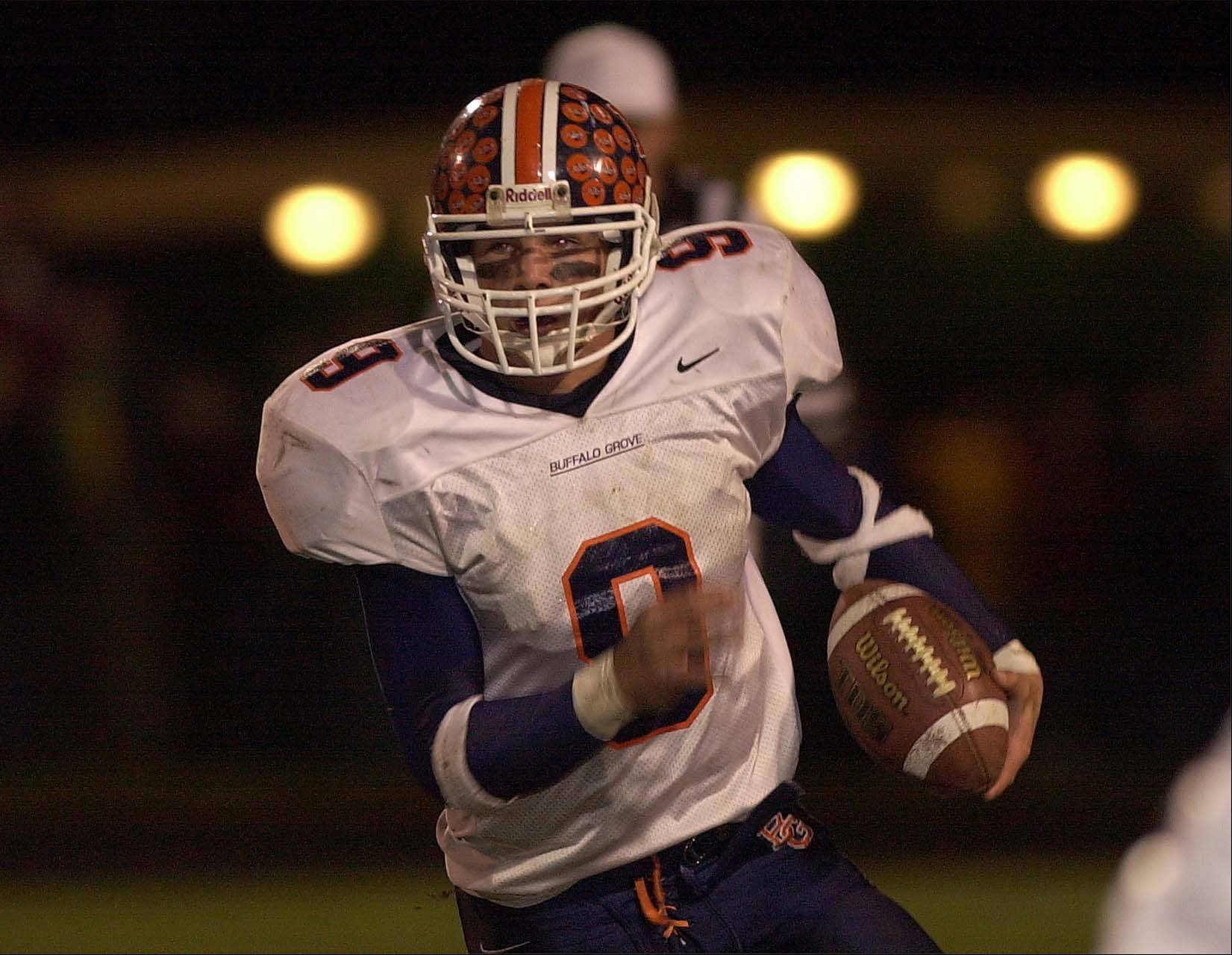 Former Buffalo Grove quarterback Tom Zbikowski takes off on a touchdown run during the 2002 IHSA football playoffs. Zbikowski also played defensive back for the Bison.