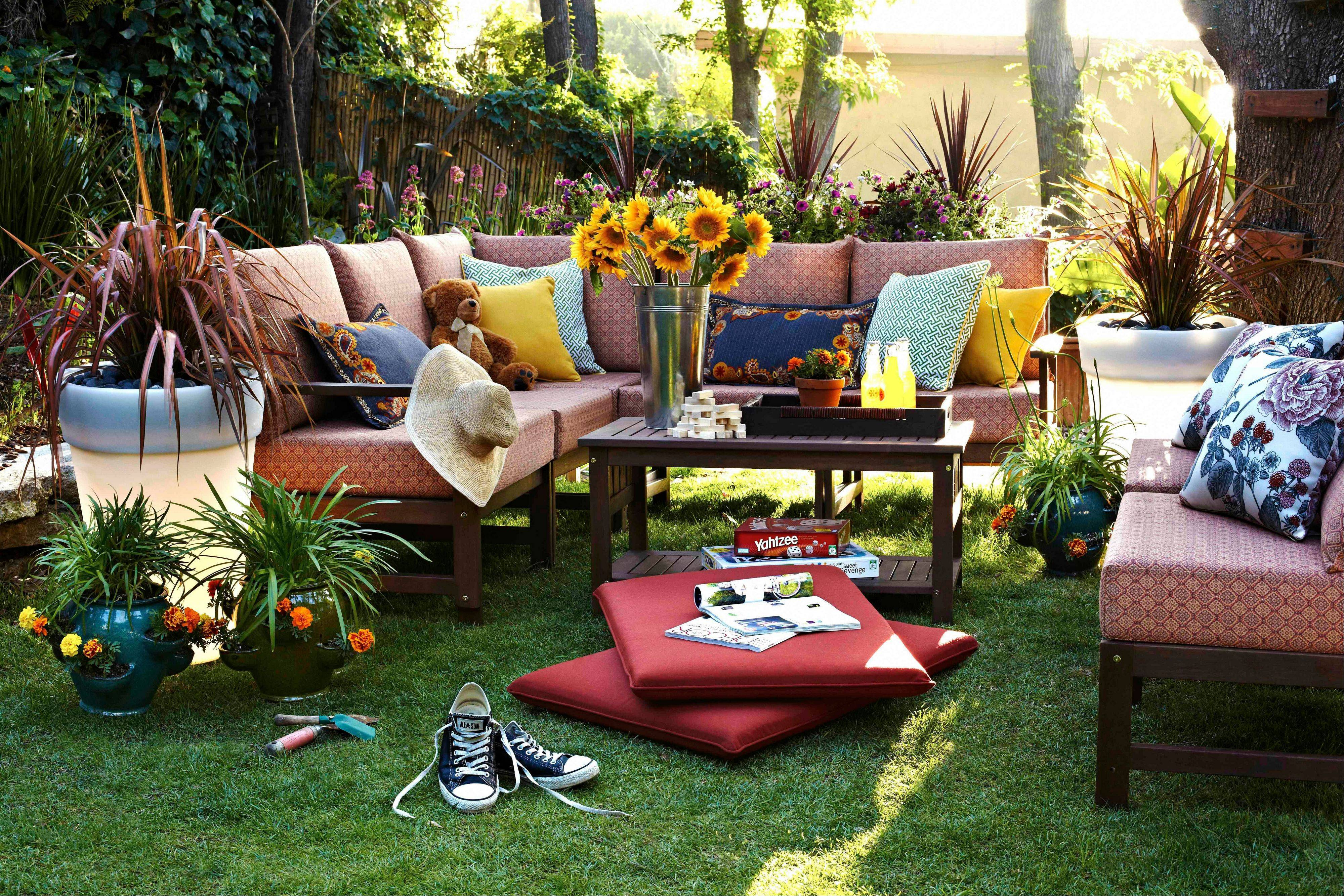Plastic planters that are designed to light up at night were added to an outdoor family room.