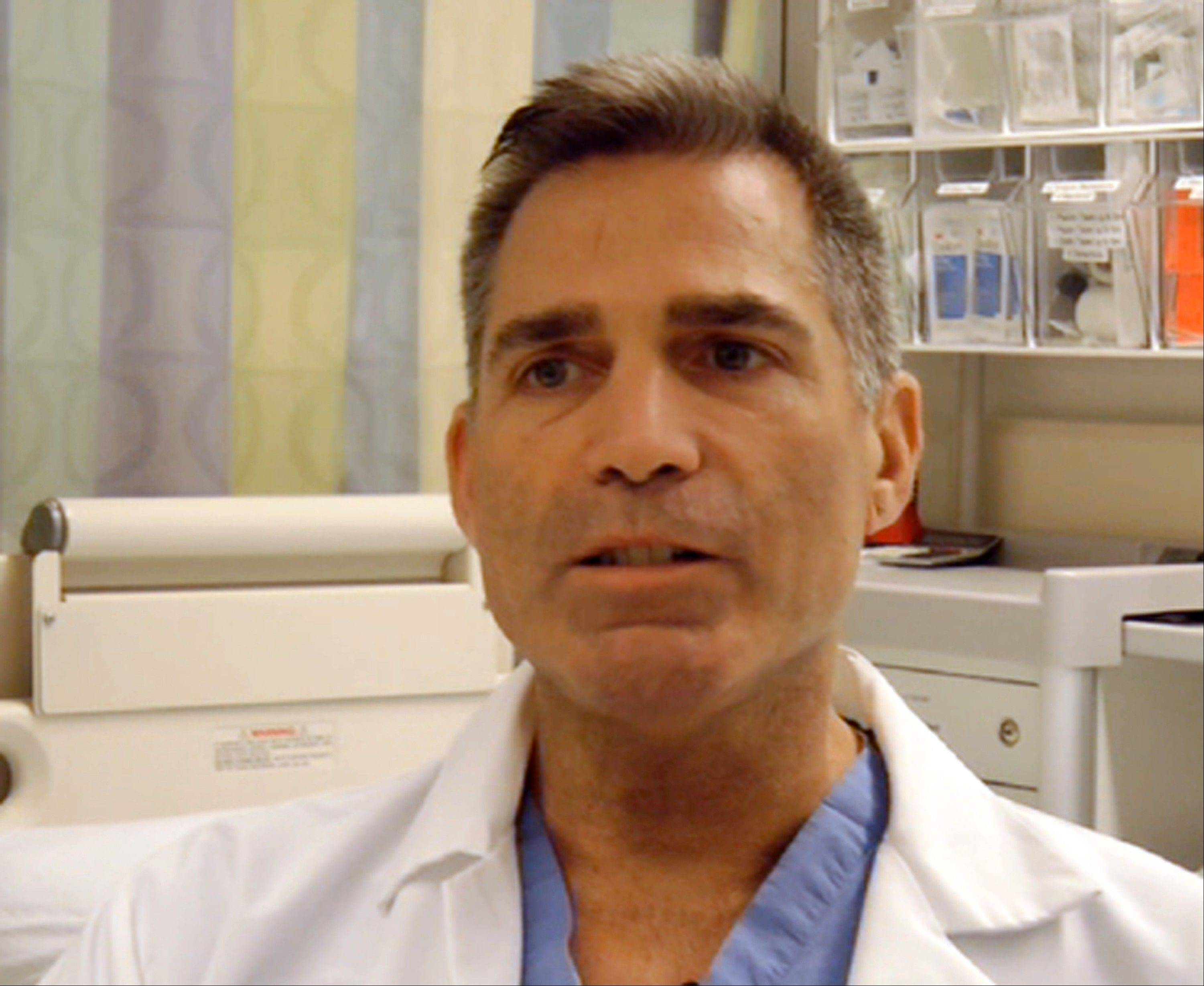 In this frame grab from Saturday, April 20, 2013, video, Massachusetts General Hospital nurse Adam Barrett talks about the horrific early hours as bloody patients poured in after the explosions at the Boston Marathon.