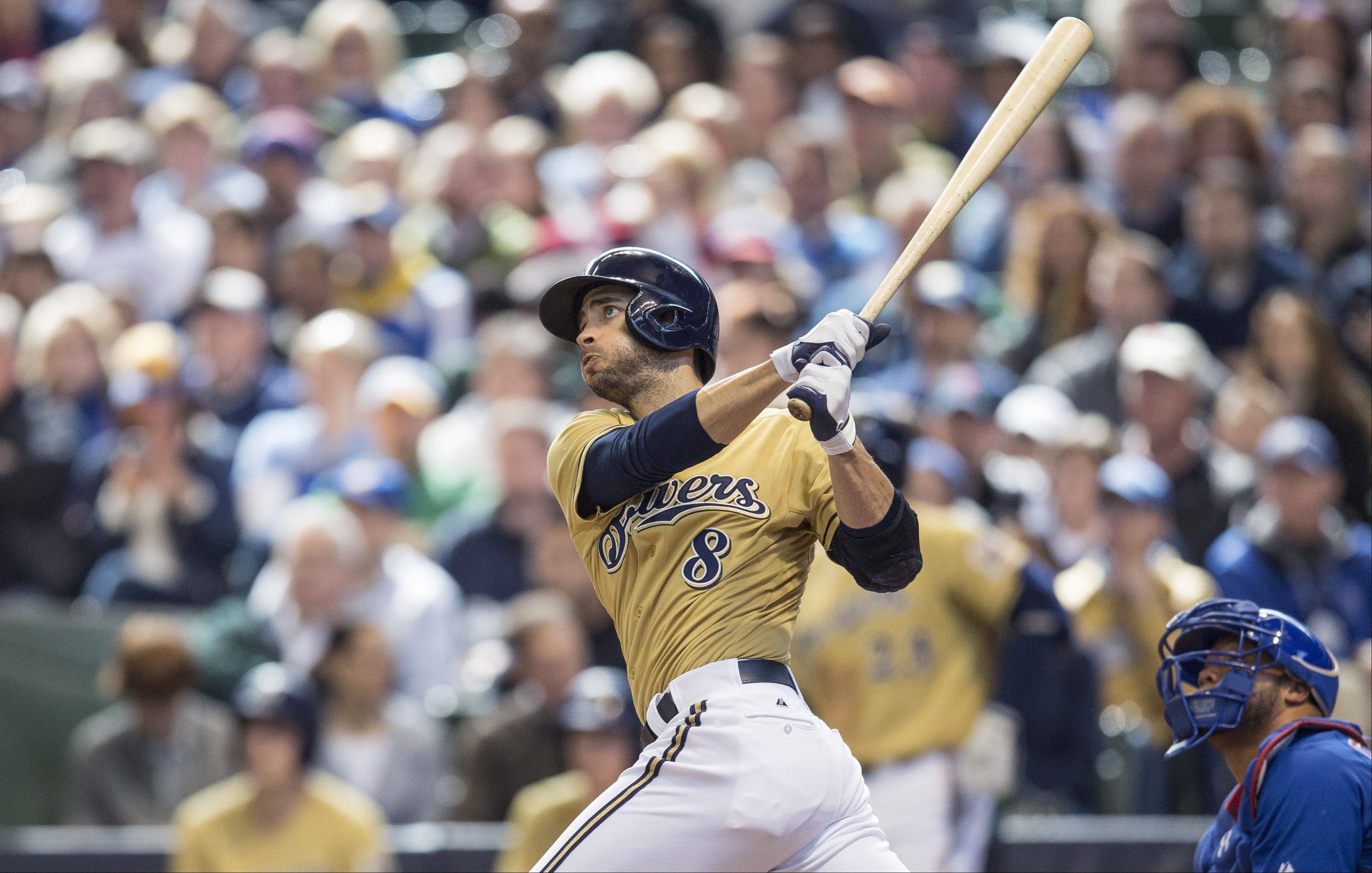 The Brewers� Ryan Braun connects for a 3-run, game-deciding home run off Cubs starter Scott Feldman in the fifth inning Sunday. It was Feldman�s error that extended the inning to bring Braun to the plate.