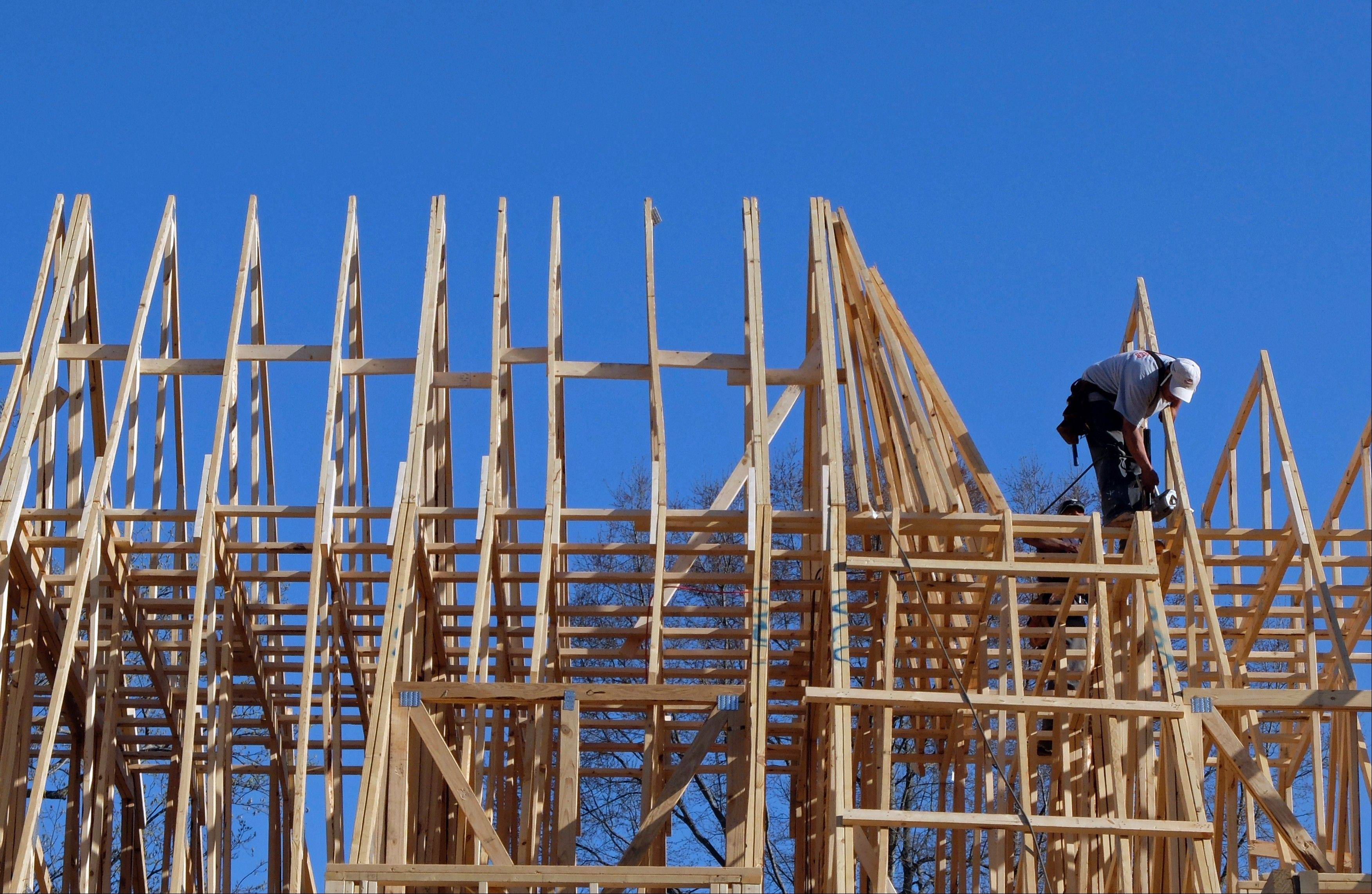 A worker helps frame a new home under construction in Matthews, N.C. U.S. homebuilders are concerned that limited land and rising costs for building materials and labor will slow sales in the short term.