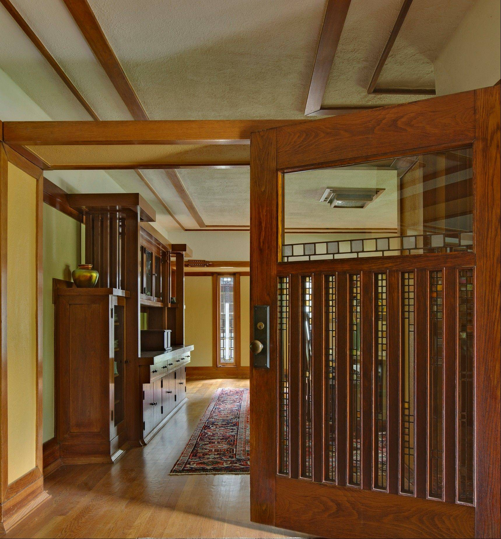 The colorful glass and Prairie style that became the hallmark of Frank Lloyd Wright's architecture can be seen in the Harry S. Adams House, 1913.