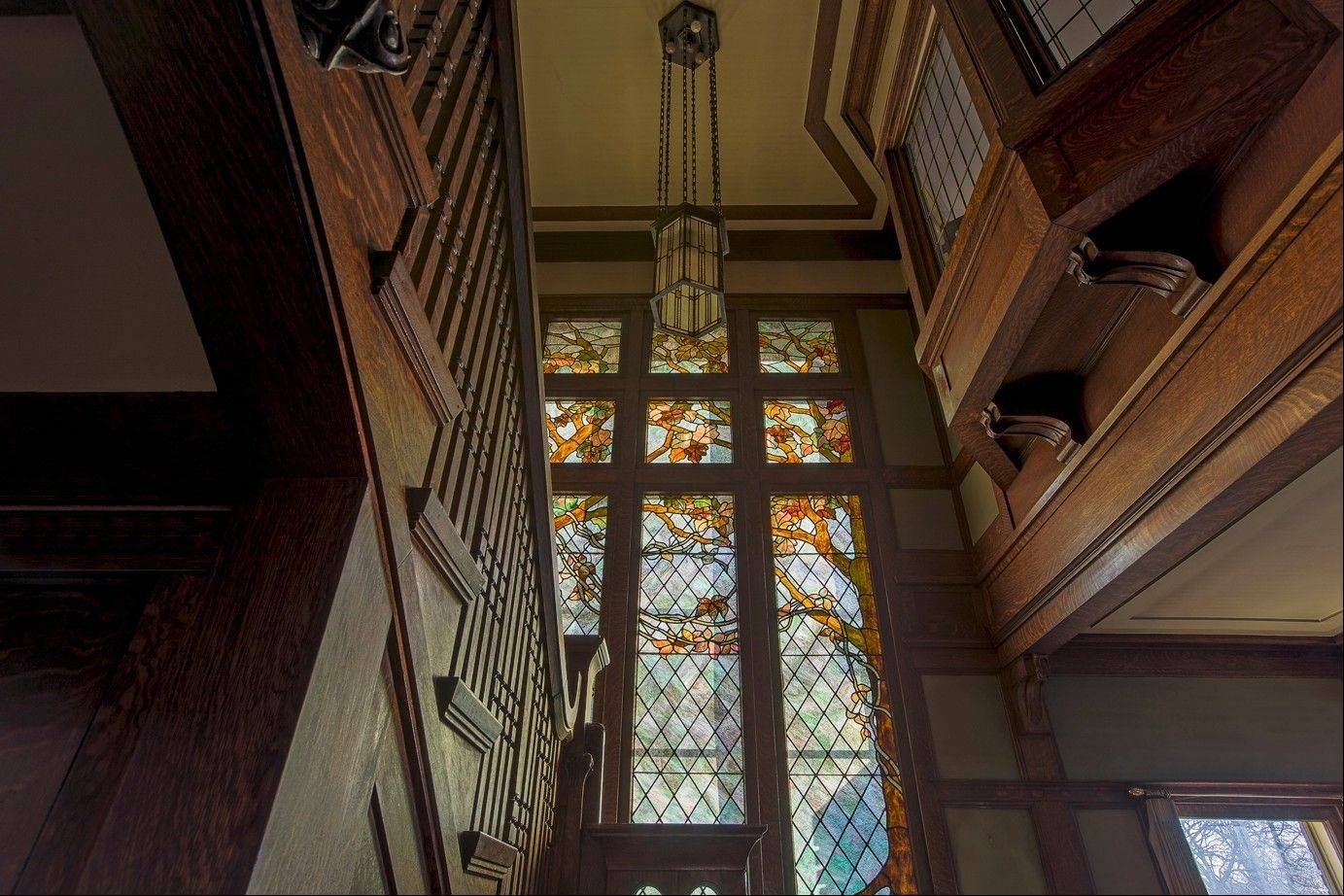 Original art glass and oak millwork grace the stairwell of the Dr. Charles E. Cessna House, built in 1905 and designed by E.E. Roberts.