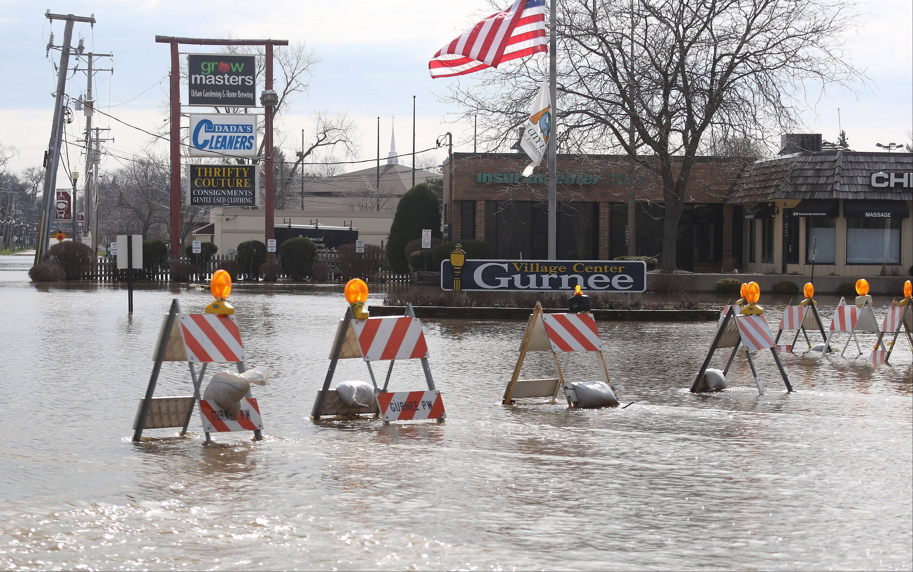 The streets of downtown Gurnee are underwater after flooding along the Des Plaines River Sunday.