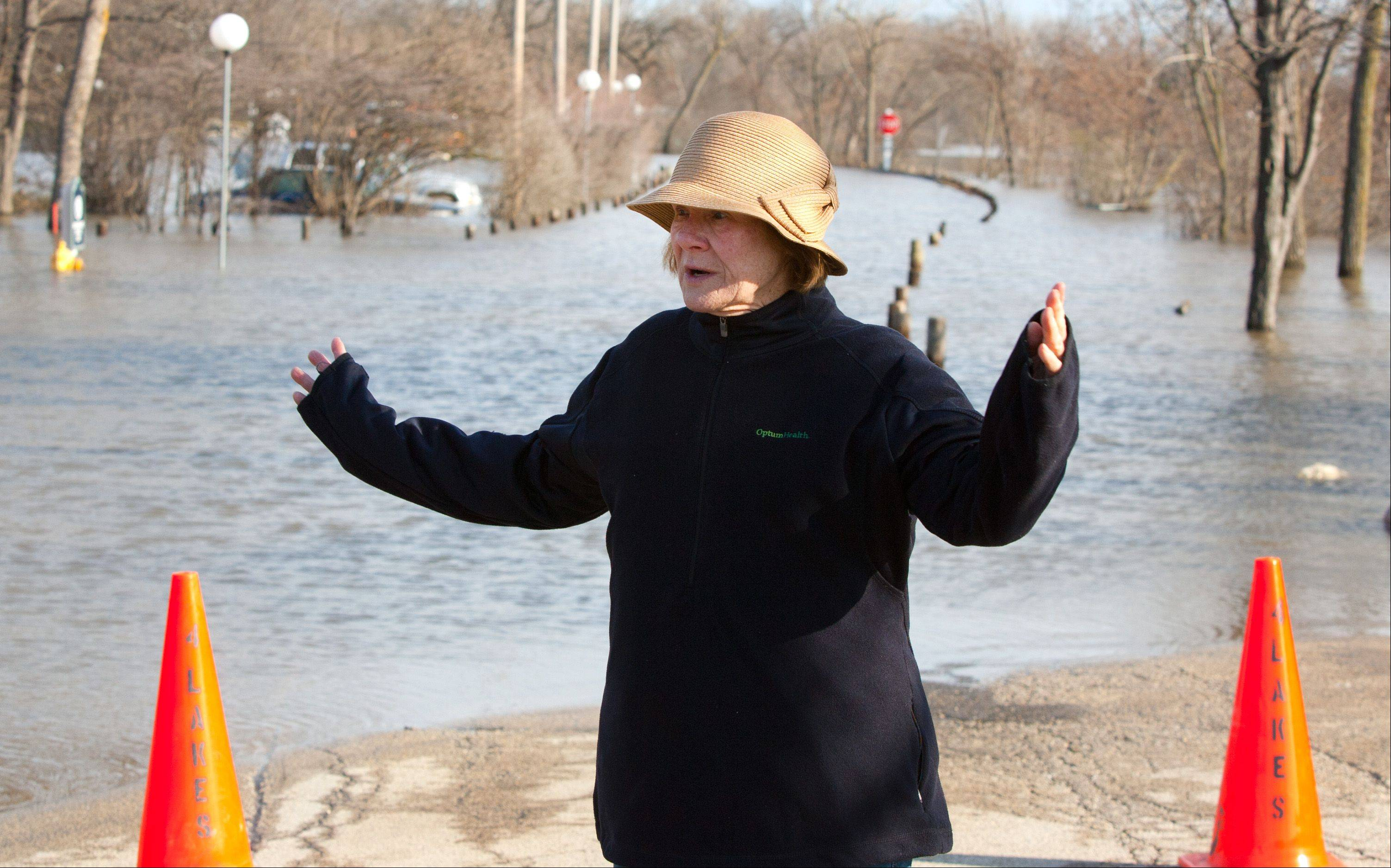 Towers at Four Lakes resident Barbara Joan Boudette talks about the volume and velocity of floodwater that engulfed many Lisle properties. There is only one road in and out of her side of the apartment complex.