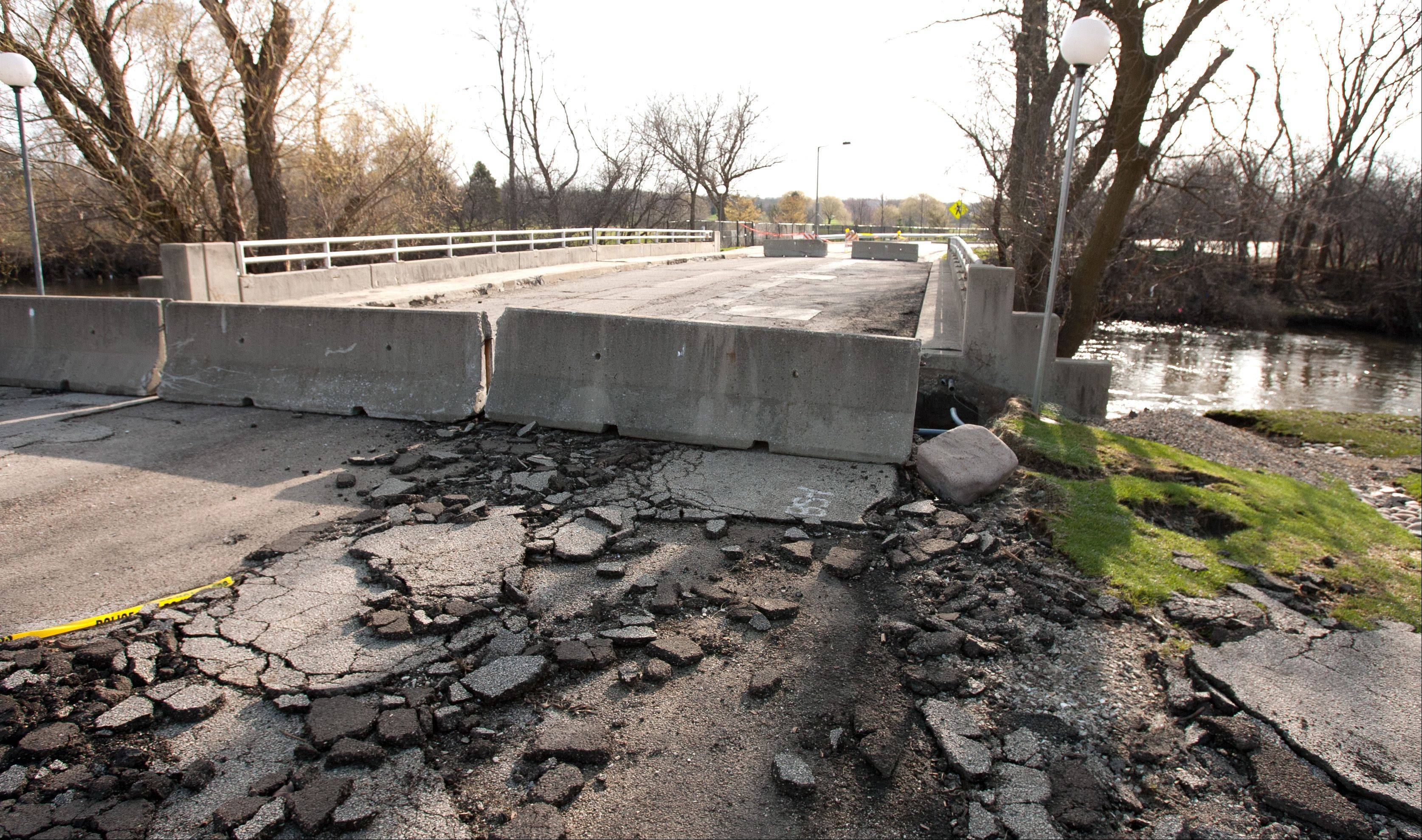 A bridge connecting areas of Four Lakes at East Lake Drive and Four Lakes Avenue was closed Sunday.