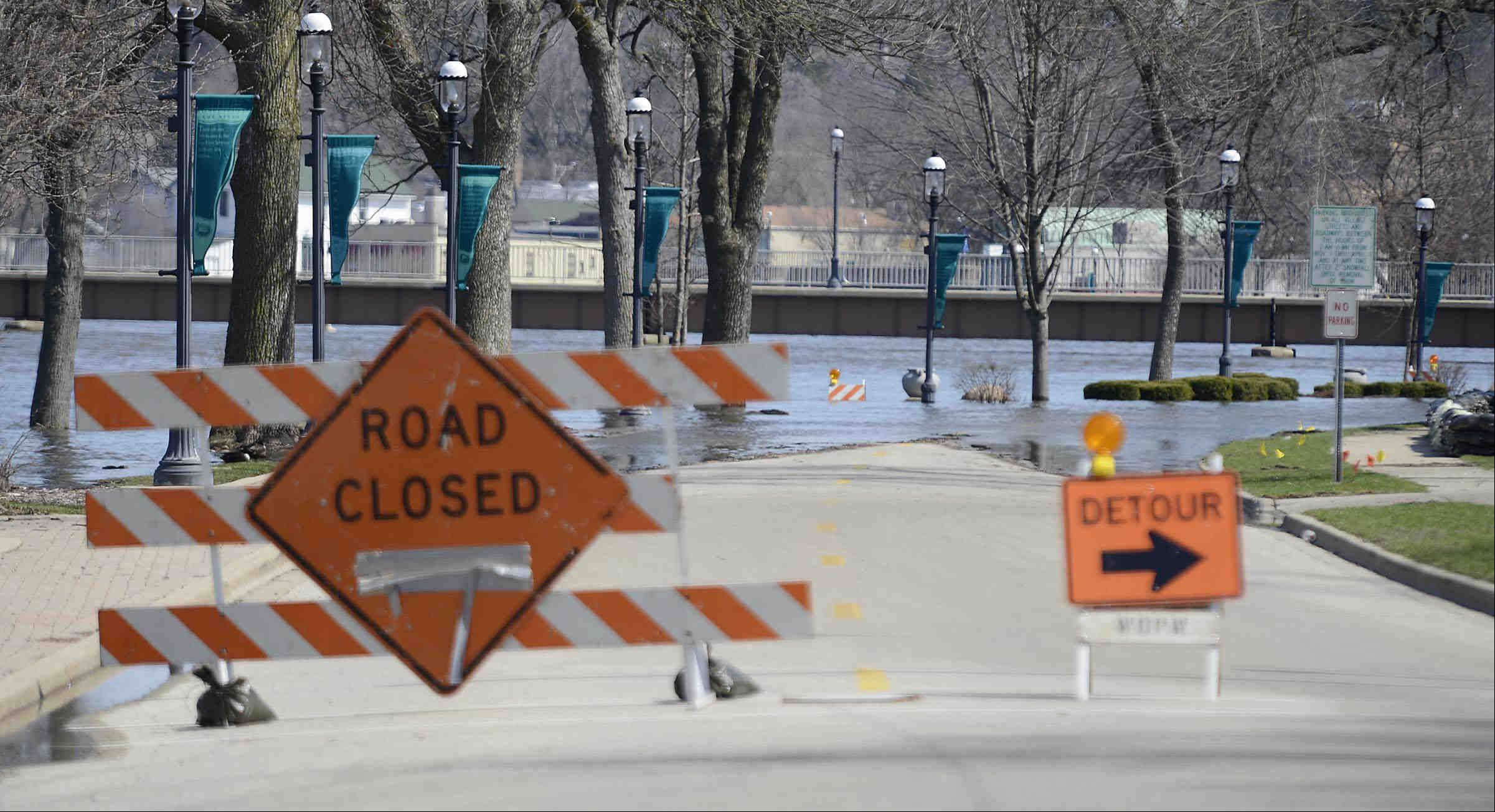 Fox River water covers South Lincoln Avenue near downtown West Dundee Sunday.